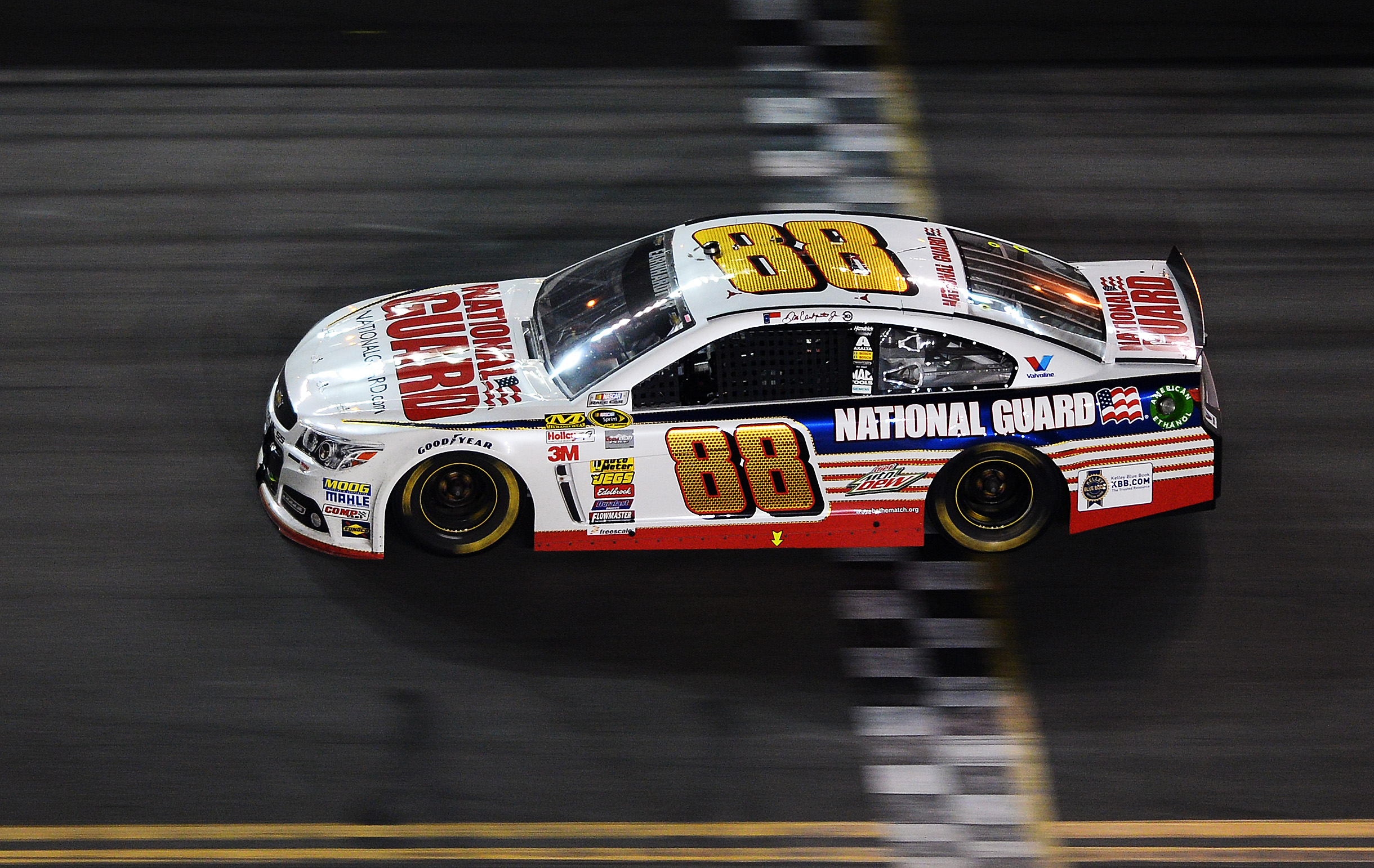 Dale Earnhardt Jr., driver of the #88 National Guard Chevrolet, crosses the finishline to win the NASCAR Sprint Cup Series Daytona 500 at Daytona International Speedway on Fec. 23, 2014 in Daytona Beach, Fla.