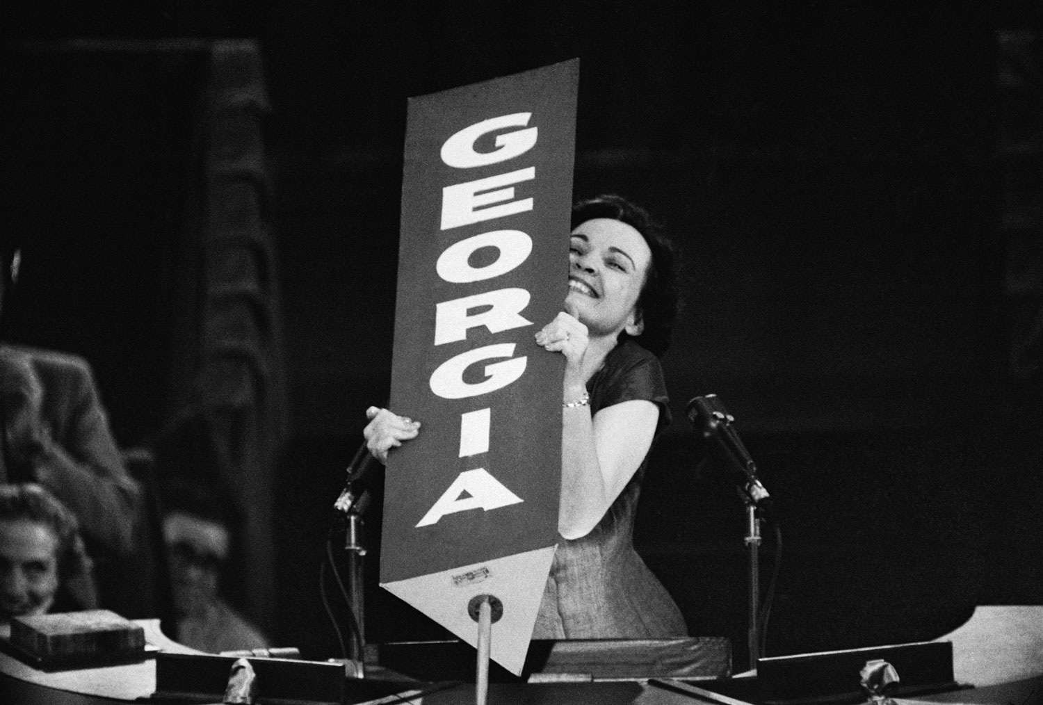 Georgia Congresswoman Iris Blitch, a staunch segregationist during her time in Congress, being saluted by her state's delegates before her speech at the 1956 Democratic National Convention in Chicago.