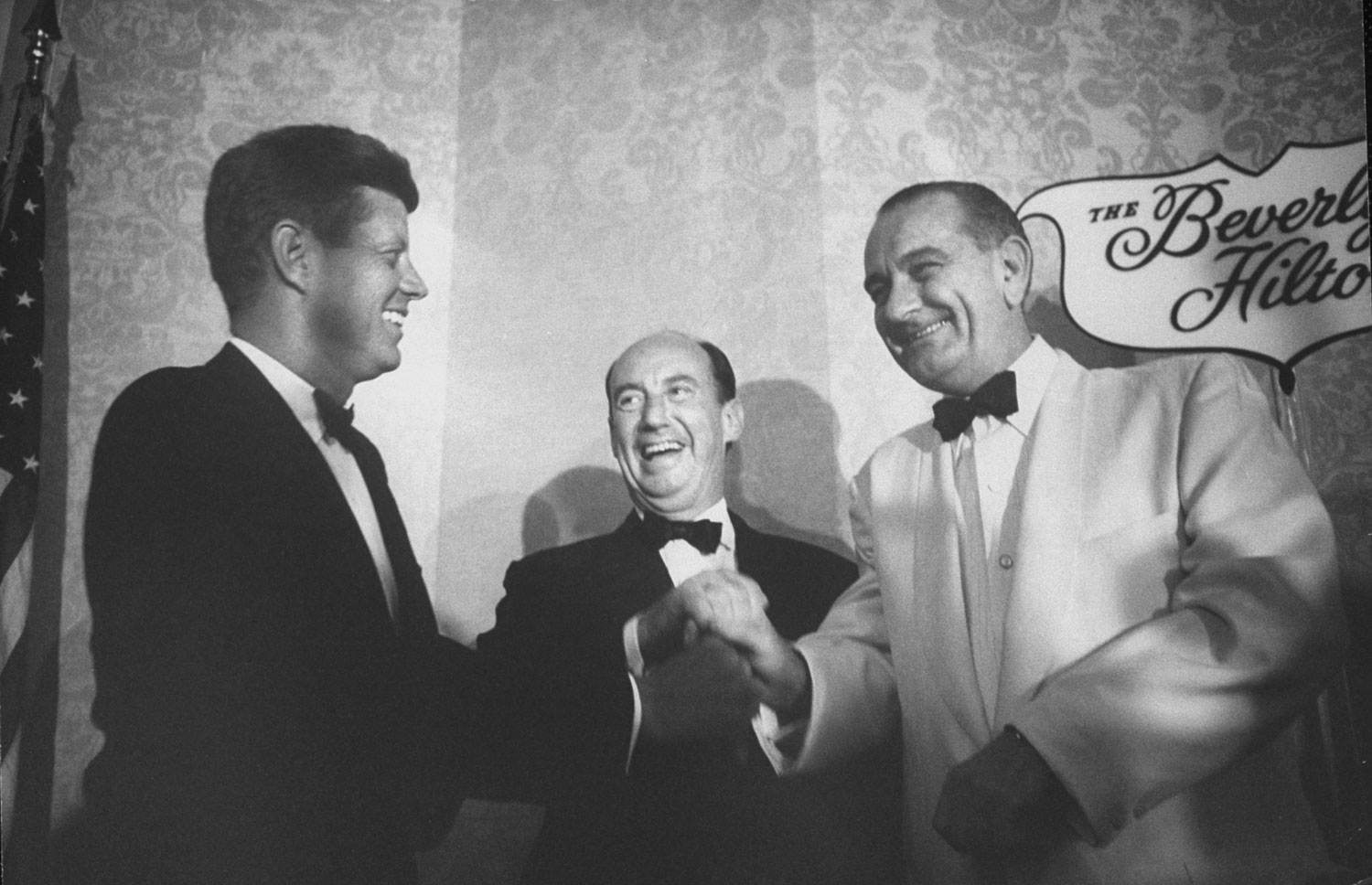 Adlai Stevenson (center) and Lyndon Johnson (right) congratulate John F. Kennedy on winning the party's presidential nomination at the 1960 Democratic National Convention in Los Angeles.