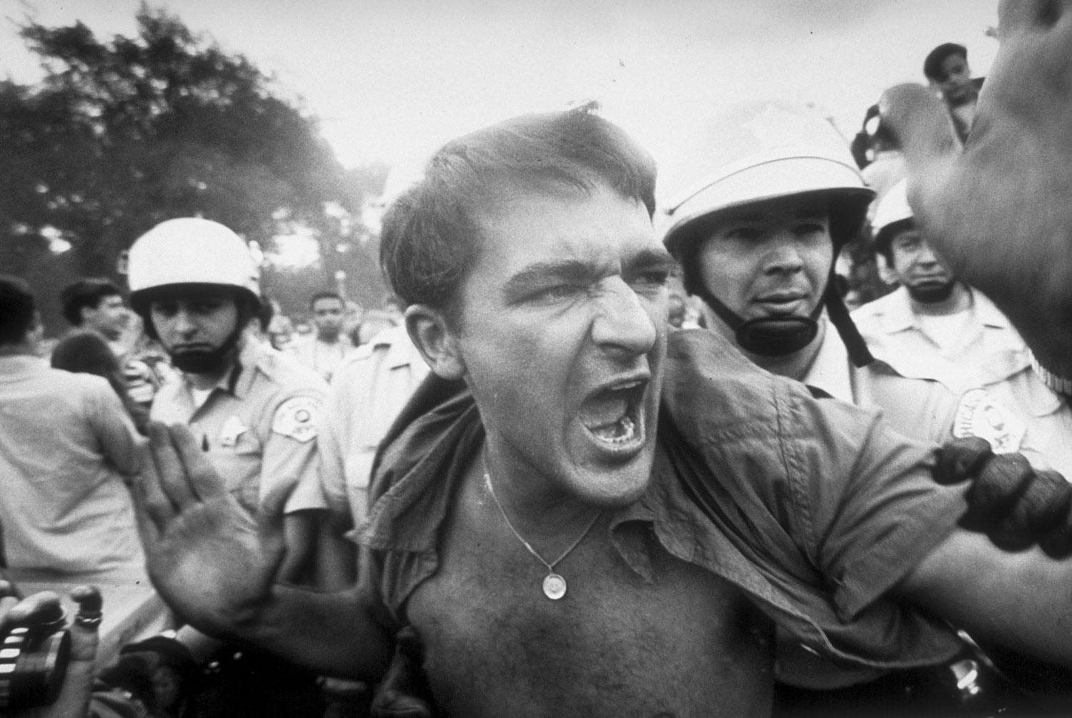 A protestor is grabbed by police during a demonstration outside the Democratic National Convention in Chicago, 1968.