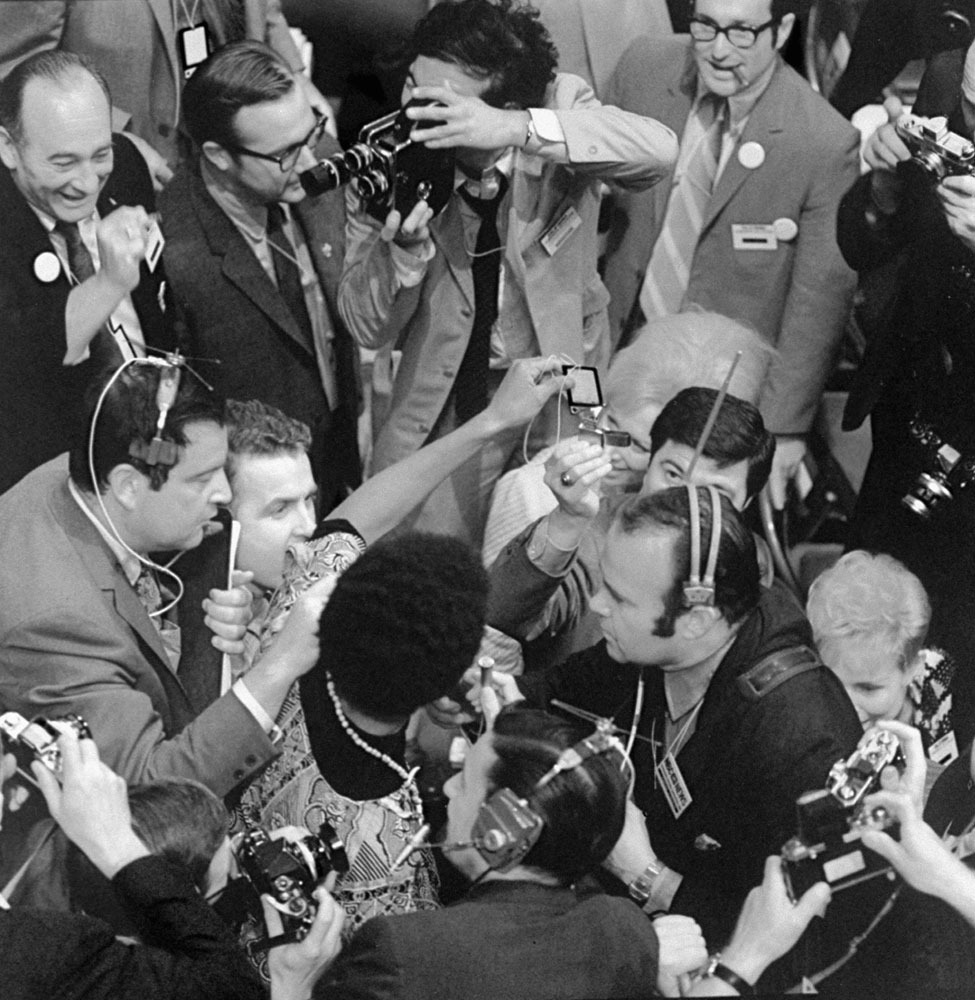 California delegate Charles Anderson burns his credentials to protest the party's decision to seat only half of Georgia's civil rights delegation during the Democratic National Convention in Chicago, 1968.