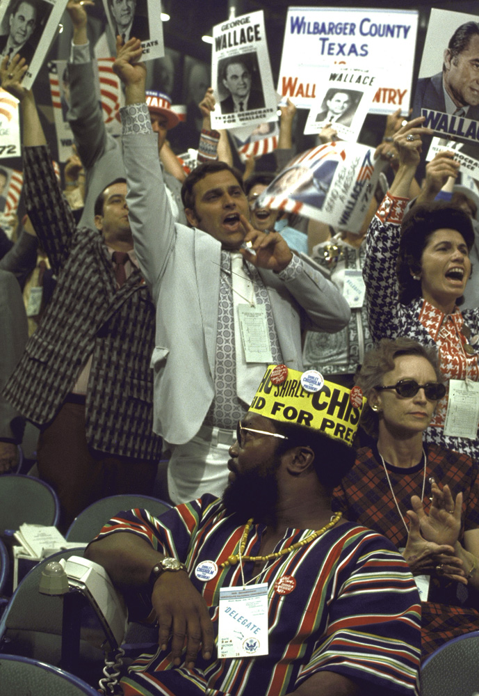 Delegates for Alabama's George Wallace cheer behind a delegate for New York's Shirley Chisholm—the first African-American woman ever elected to Congress—during the 1972 Democratic National Convention in Miami Beach.