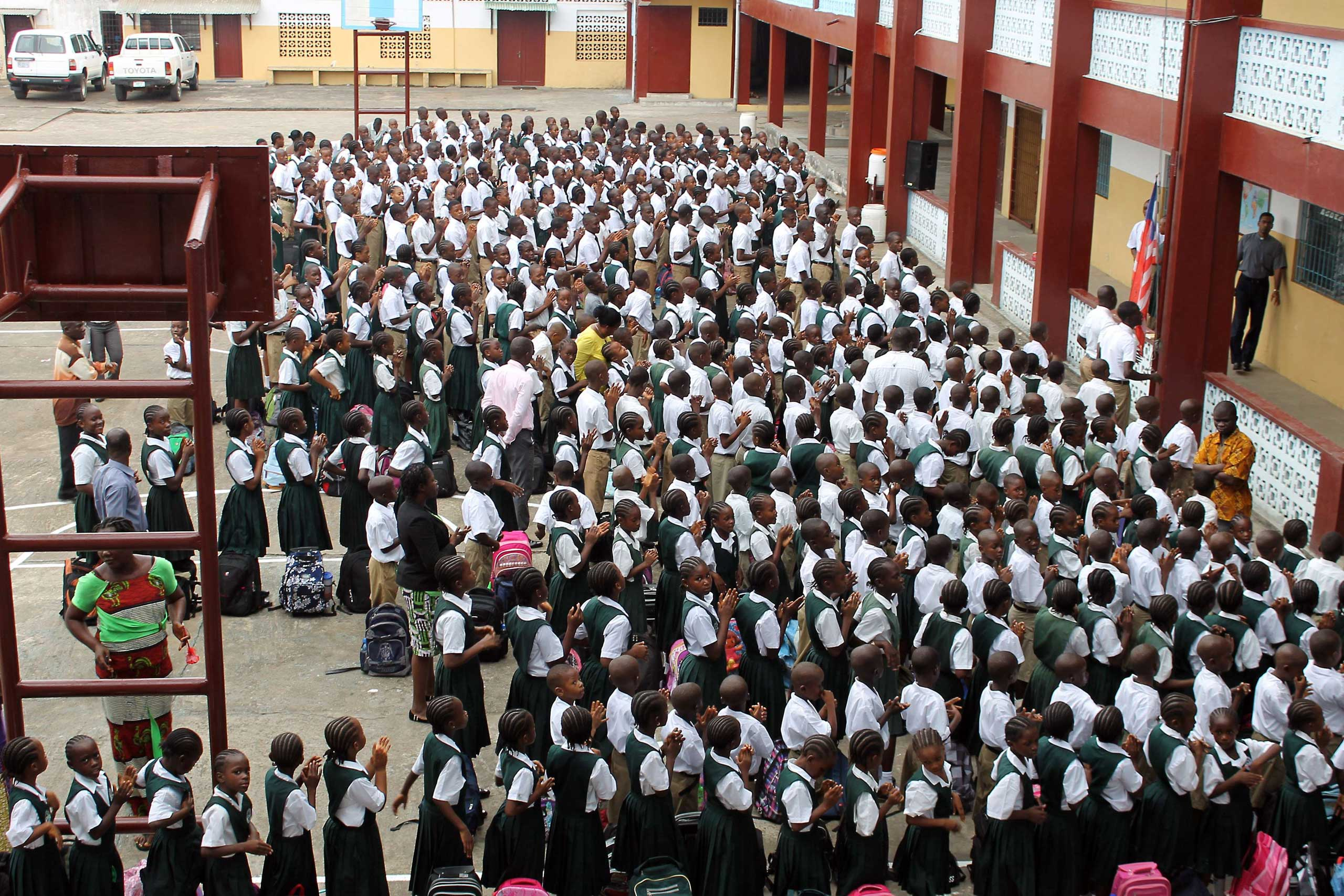 Students stand in line before heading to their classrooms at Don Bosco High School in the Liberian capital, Monrovia, on Feb. 16, 2015