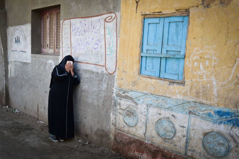 A relative of one of the Egyptian Coptic Christians purportedly killed by ISIS militants in Libya reacts after hearing the news on Feb. 16, 2015 in the village of Al-Awar in Egypt's southern province of Minya.