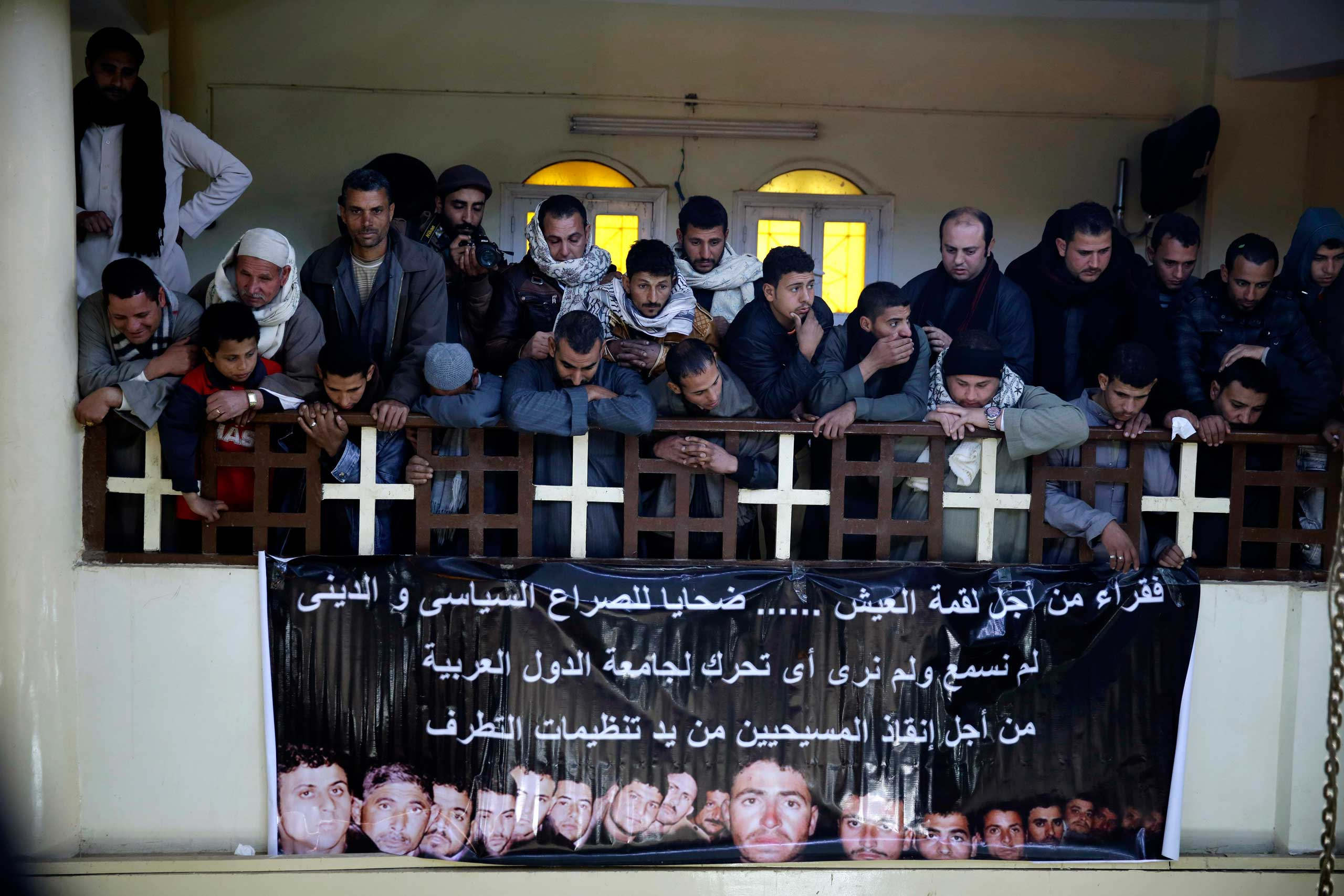 Village residents inside the Virgin Mary Church in al-Our, Egypt, on Feb. 16, 2015, mourn Egyptian Coptic Christians who were captured in Libya and killed by ISIS militants