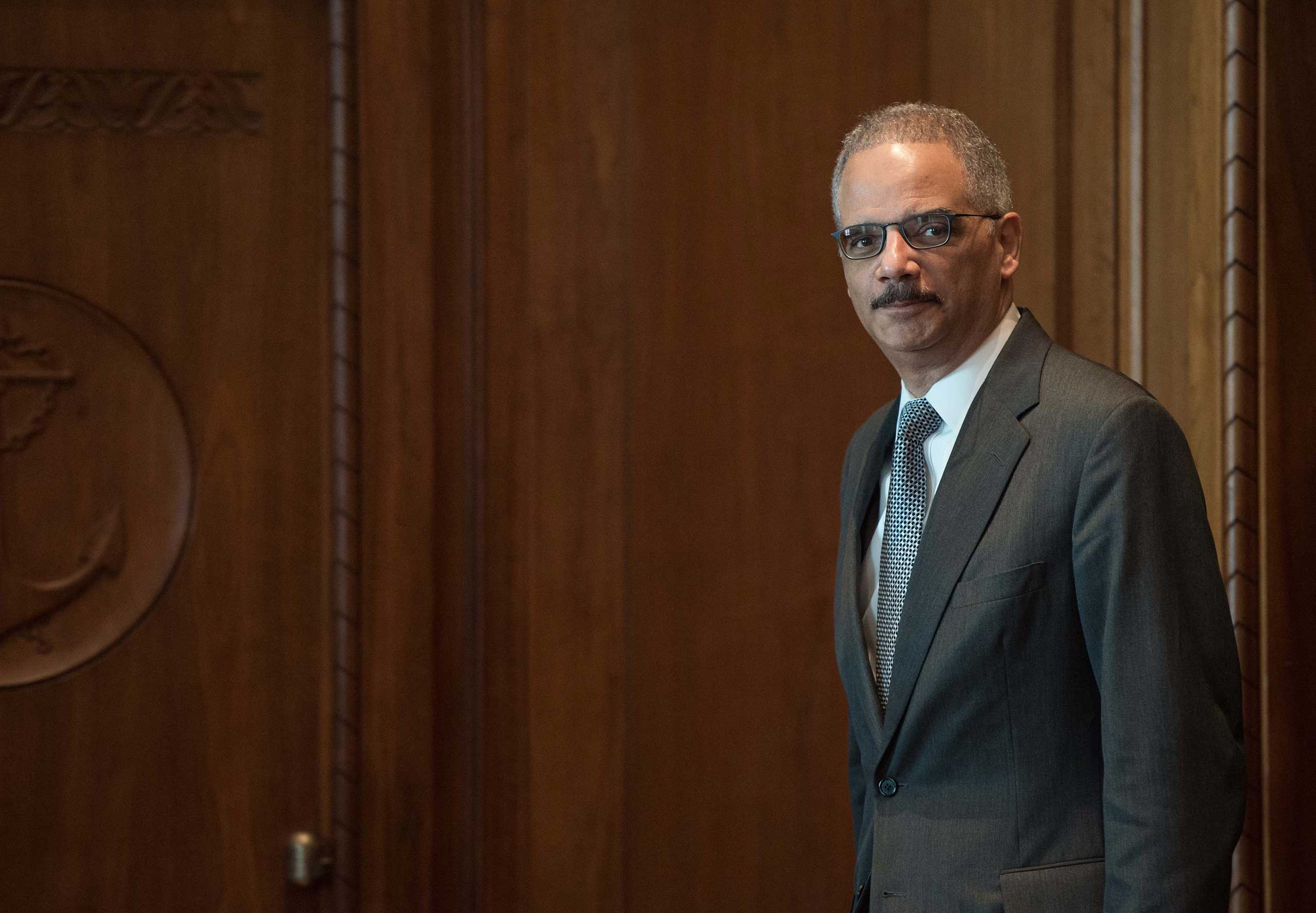 US Attorney General Eric Holder arrives for a meeting with French Interior Minister Bernard Cazeneuve at the Justice Department in Washington on Feb. 19, 2015.