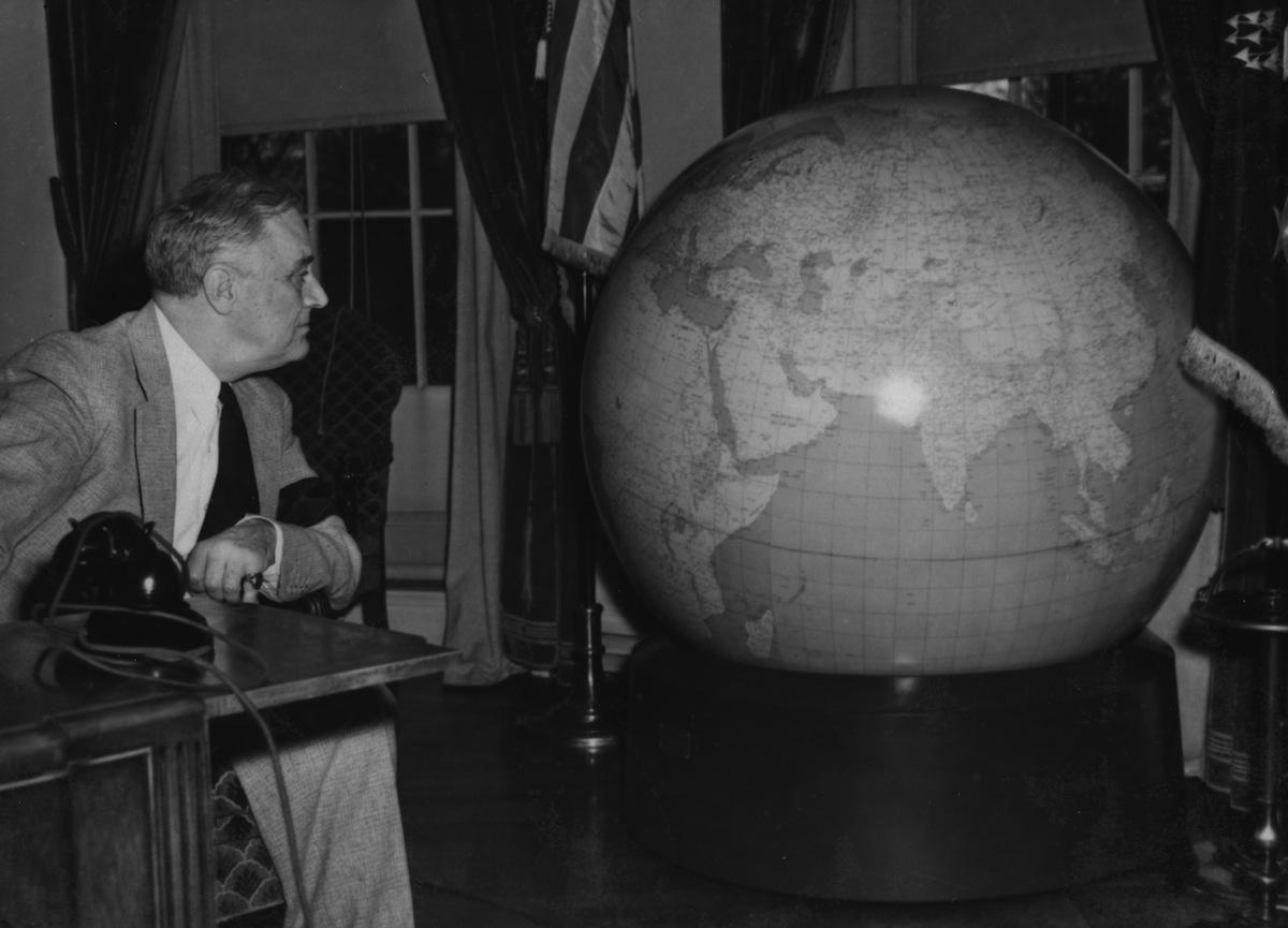 President Franklin Delano Roosevelt inspecting a globe, circa 1942