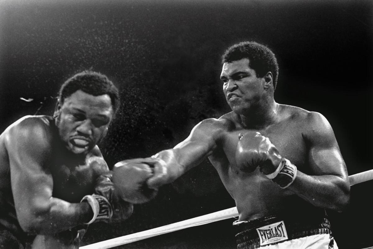 Ali, right, fights Joe Frazier in Manila, 1975