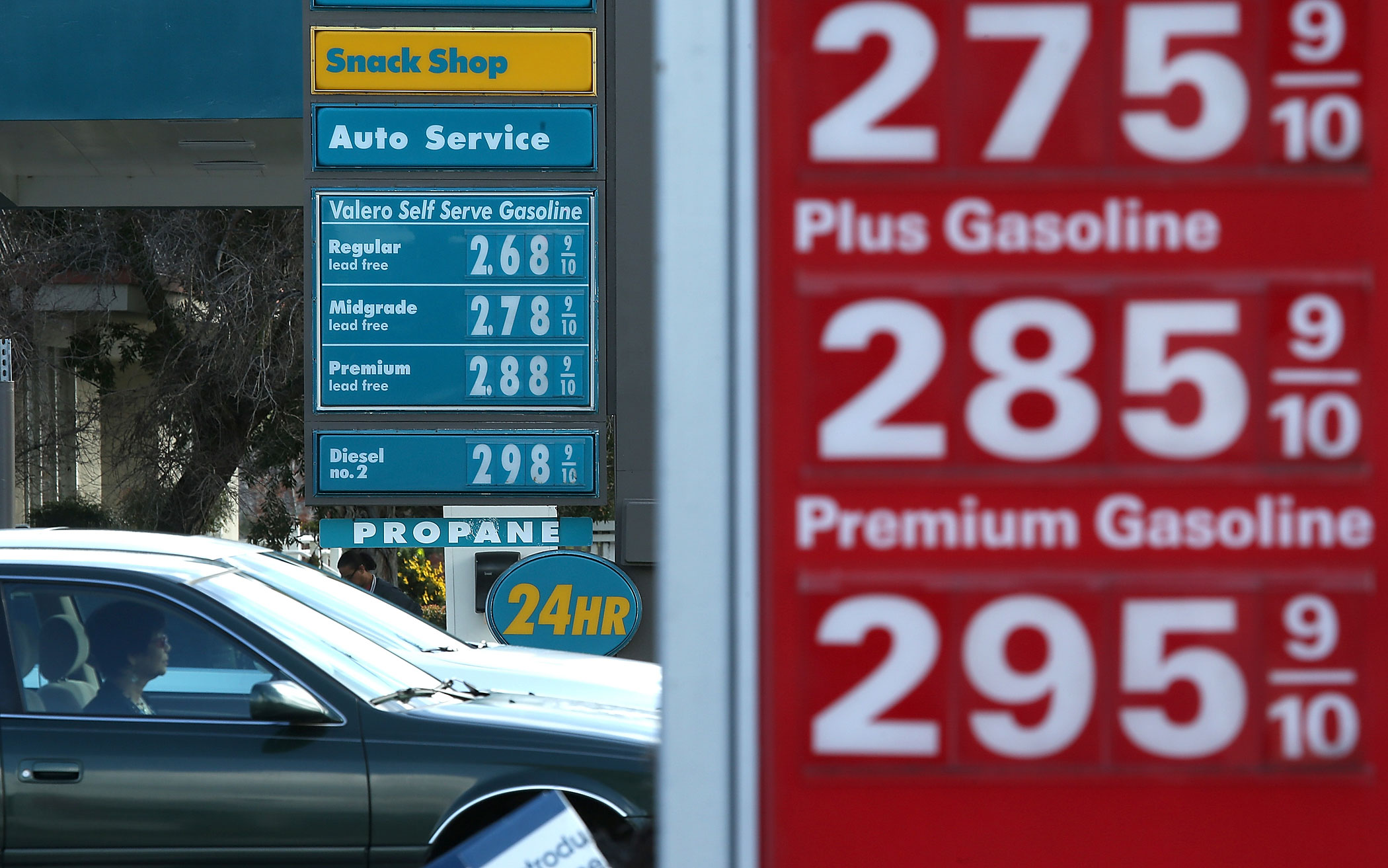 Drivers pass by gas prices that are displayed at Valero and 76 gas stations on Feb. 9, 2015 in San Rafael, Calif.