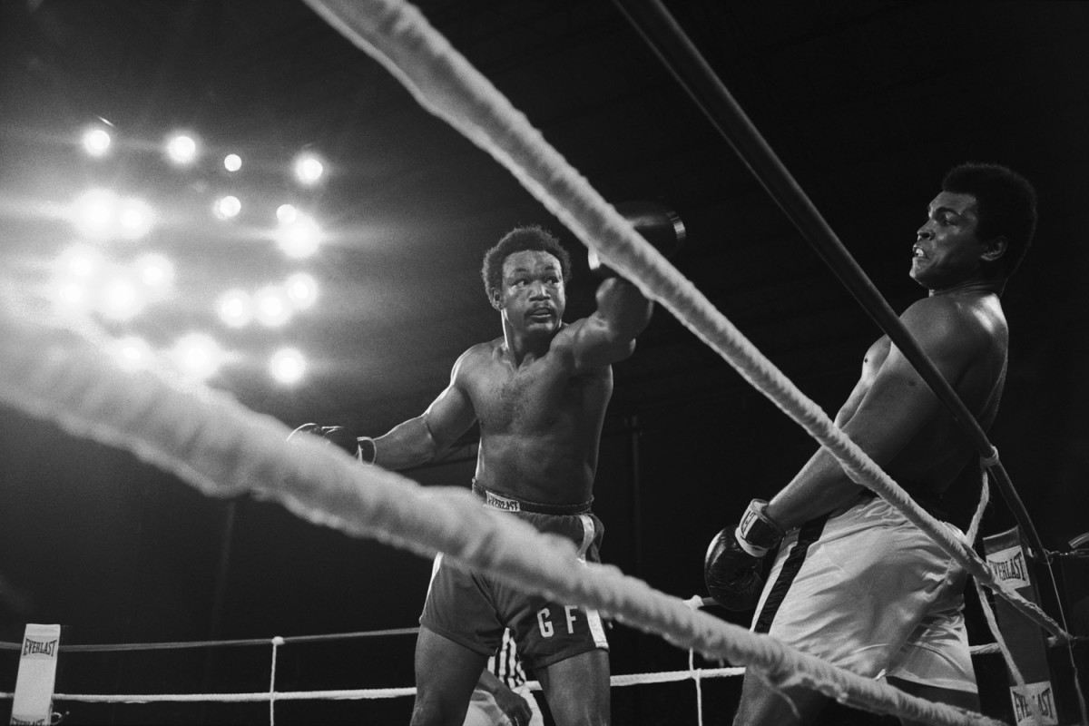 Ali avoids a punch by George Foreman in Kinshasa, Zaire, 1974                               Larry Merchant:   Like many writers of that day, I had a professional and personal relationship with him. He was a great athlete and a pied piper who everyone wanted to follow. He was the biggest kid and the strongest man. We were flying to Zaire for the fight with George Foreman; he sat down next to me and said, 'If he doesn't get me in seven, his parachute won't open. If I can stay in there with him, he'll come apart.' He used the rope-a-dope tactic, which was improvised, and he found that Foreman was inescapable. He was informed by this observation that Foreman would wear himself out. Ali knocked him out in the eighth round. There was no one else on the planet who could have done it. He could do magic tricks. He has this twinkle in his eye — it is his playfulness, bombast and politics, all of which were virtually unique in an elite athlete.                                                                Larry Merchant is a former sportswriter and longtime commentator for HBO Sports.