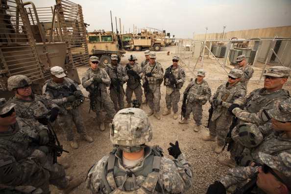 U.S. troops getting a last-minute briefing before leaving Iraq in 2011.