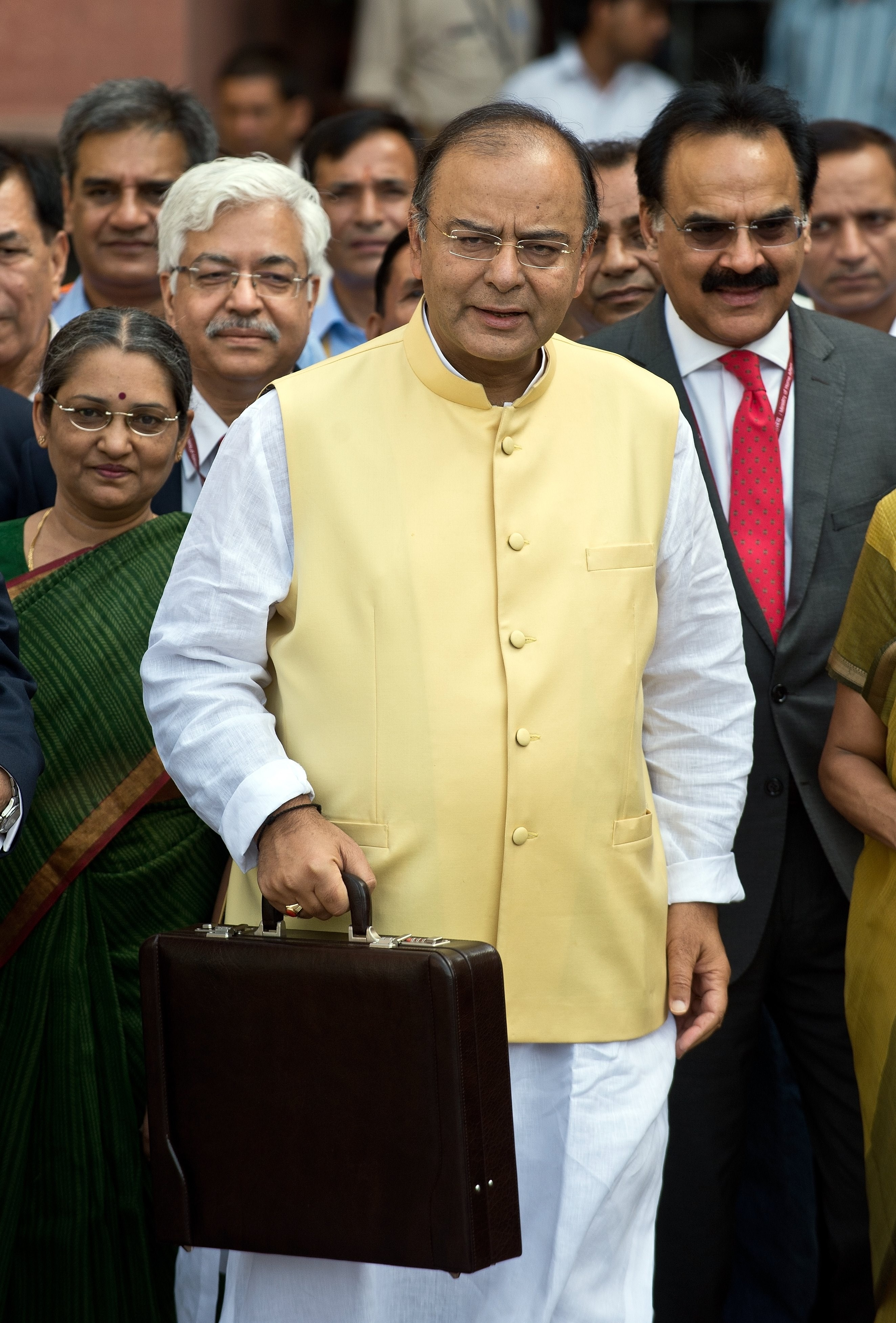 Indian Finance Minister Arun Jaitley, center, leaves his office to table the budget in Parliament in New Delhi on July 10, 2014