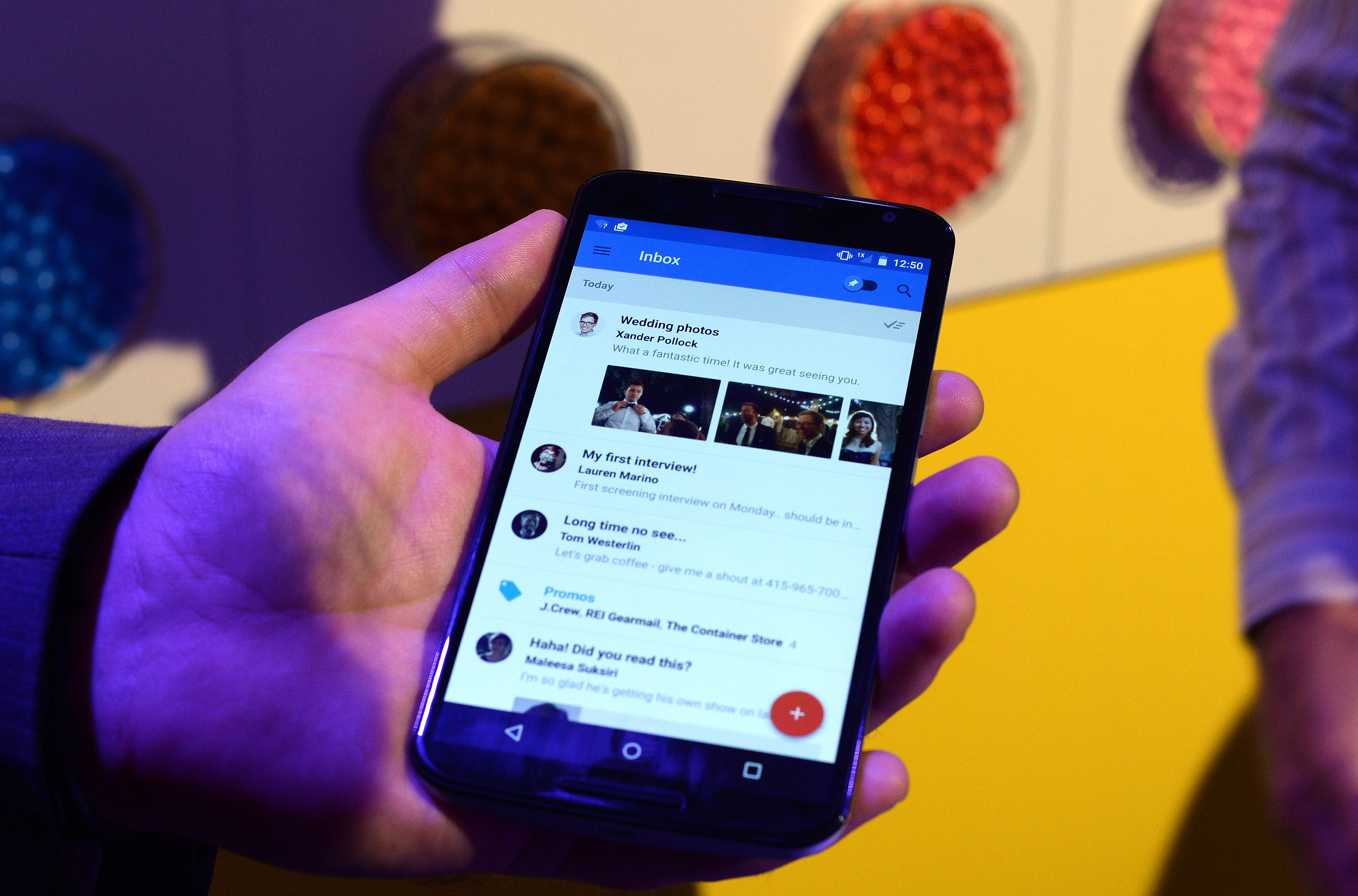 Google's lead designer for  Inbox by Gmail  Jason Cornwell shows the app's functionalities on a Nexus 6 android phone during a media preview in New York on October 29, 2014.