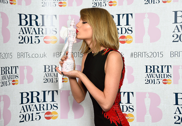 Singer Taylor Swift, winner of the International Female Solo Artist Award, poses in the winners room during the BRIT Awards 2015 at the O2 Arena in London on Feb. 25, 2015