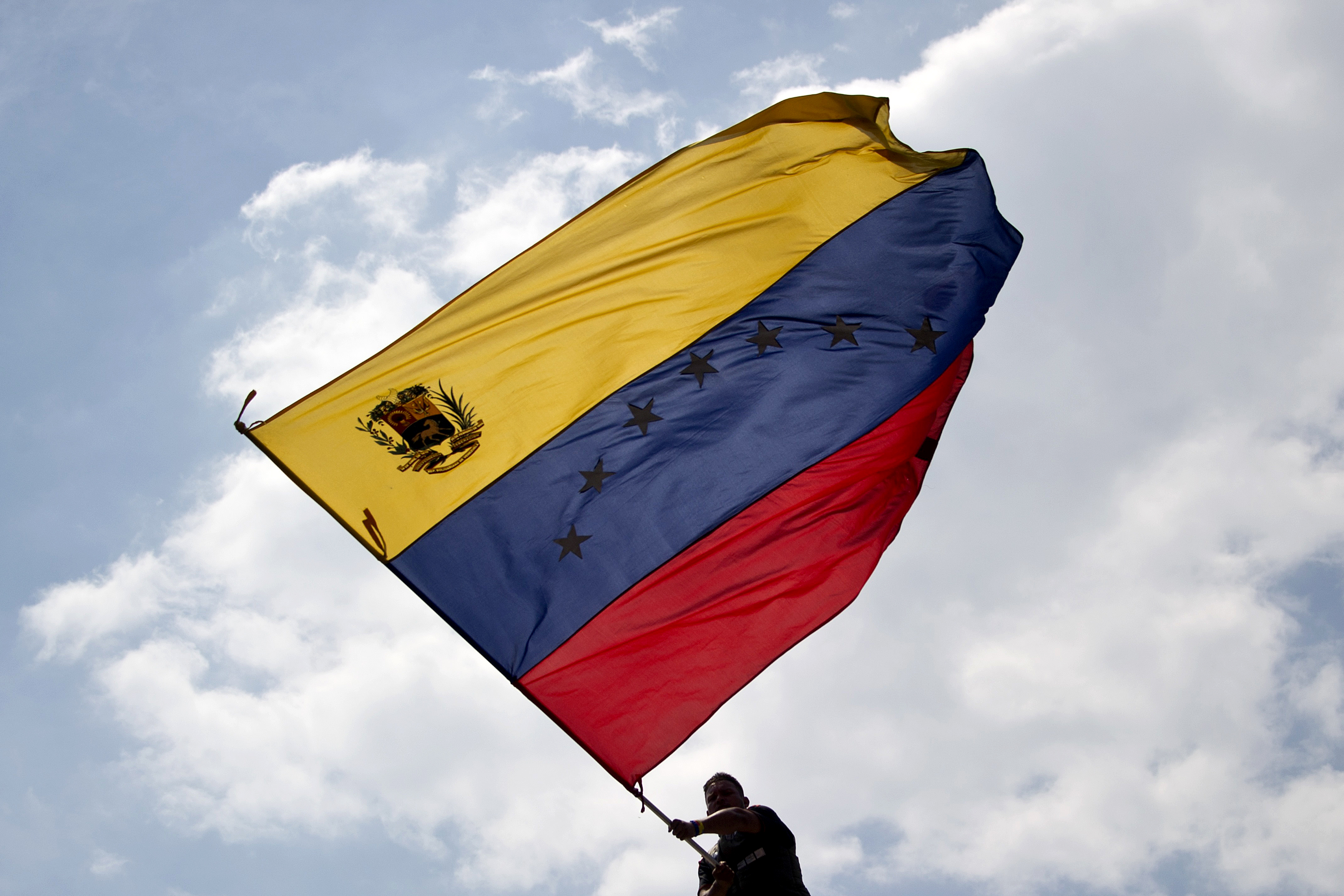 A man waves a Venezuelan flag during a protest against the government of President Nicolas Maduro in San Cristobal, Venezuela, on Feb. 22, 2014.