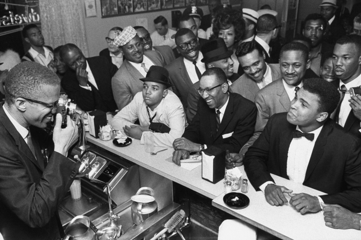 Malcolm X and Muhammad Ali in Miami, 1964                               Dr. Todd Boyd:  On Feb. 25, 1964, the former Cassius Marcellus Clay shook up the world. Two months later, I would make my own entrance into the world that he had shaken. Let's just say that I was born under the sign of Ali. Over the course of my life, as I came to appreciate his, I would be inspired by the walk that he walked and the talk that he talked. Ali taught me that in spite of the haters who may diligently attempt to stagnate my own progress, I could still mount a defiant resistance to the dictates of the conformity with style, swagger and a prodigiously poetic mouthpiece. In other words, Muhammad Ali taught me that in a land often filled with imitators, one could still manage to be an original. And for this I am eternally grateful.                                Dr. Todd Boyd is an author and a professor of critical studies at USC.