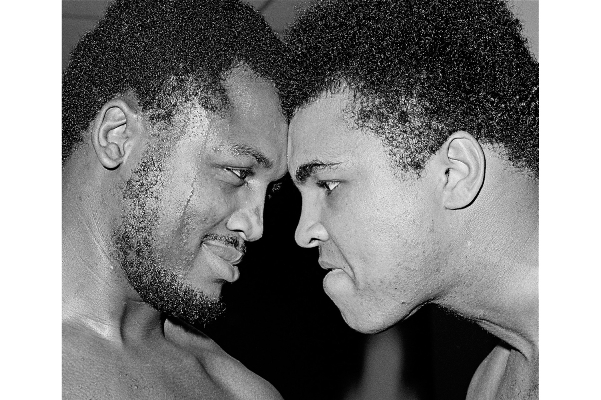 Joe Frazier and Ali at Frazier's gym in Philadelphia, 1971                               George Kalinsky:  This photo of Muhammad Ali and Joe Frazier head to head was taken in Joe Frazier's gym in February 1971, one month before the  Fight of the Century,  Ali-Frazier I. I was alone in Joe's gym with the two undefeated heavyweight champions, and I asked them to go head to head and nose to nose, which was the first time it ever had been done — nobody had ever thought of posing fighters like that before. As I started taking photos of both fighters, I asked them to start looking like they would the night of the fight. Joe started with a tap, then Ali followed ... they started jabbing, and all of a sudden Joe hit Ali in the midsection so hard that he briefly stunned Ali, who fell against the wall. Ali, being the ultimate showman, quickly pulled his trunks up to his neck and said, 'Joe Frazier, you can really hit.' Joe replied, 'Clay, that's the way it's going to be the night of the fight.'  George Kalinsky is an award-winning photographer.