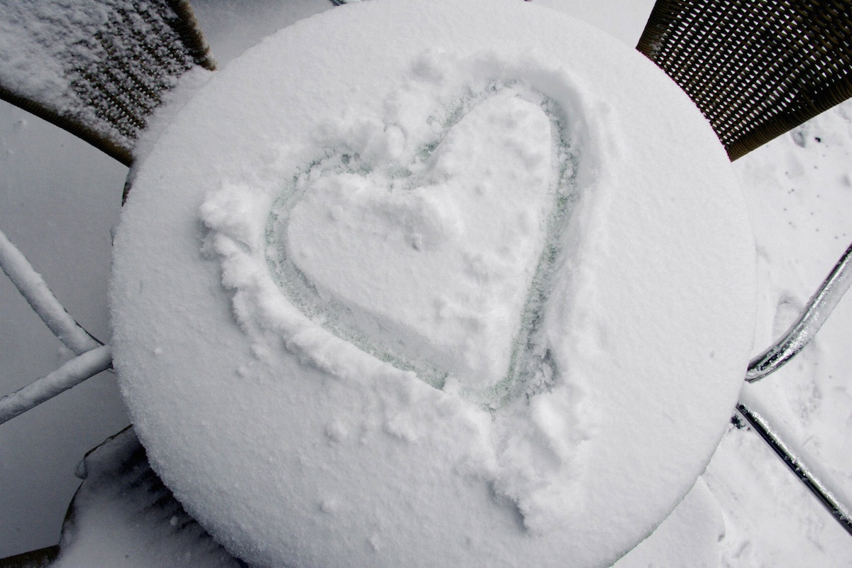 A heart is painted in the snow on a table of a sidewalk cafe in Berlin on another snowy Valentine's Day, in 2005