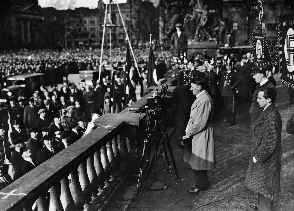 Adolf Hitler giving speech at the terrace of Royal Castle of the Lustgarten of Berlin, during his election campaign, circa 1920