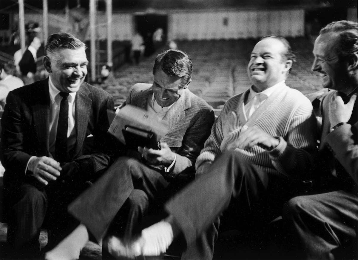 Clark Gable, Cary Grant, Bob Hope and David Niven laughing heartily together at one of Hope's recently-acquired Russian jokes during break from rehearsals for the 1958 Academy Awards