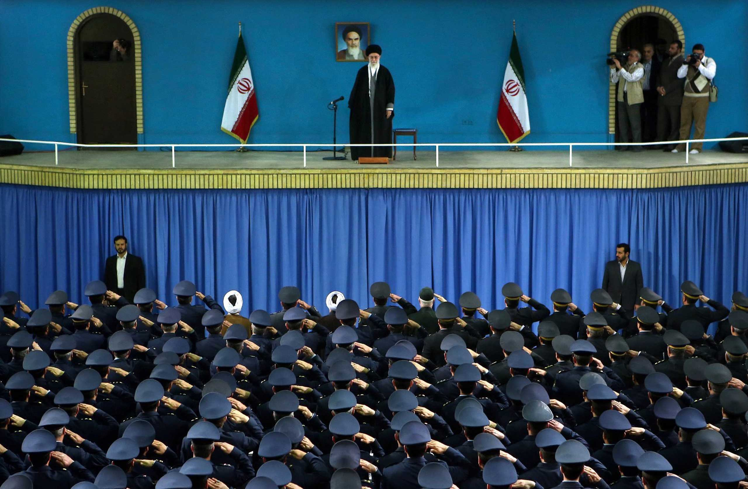 Army air force officers salute Supreme Leader Ayatollah Ali Khamenei during a ceremony in Tehran, Feb. 8, 2015.