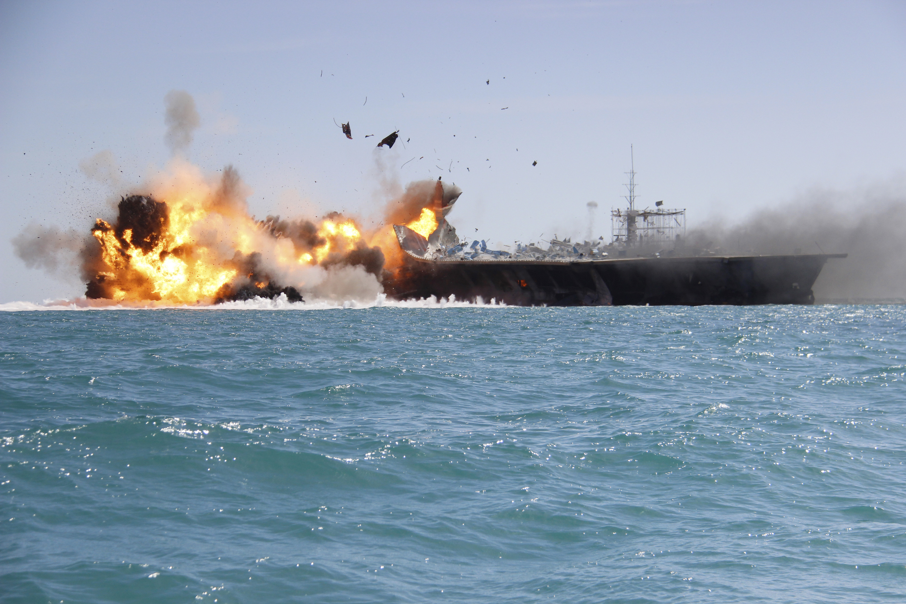 A replica of a U.S. aircraft carrier is exploded by the Revolutionary Guard during naval drills near the entrance of the Persian Gulf, Iran on Feb. 25, 2015.