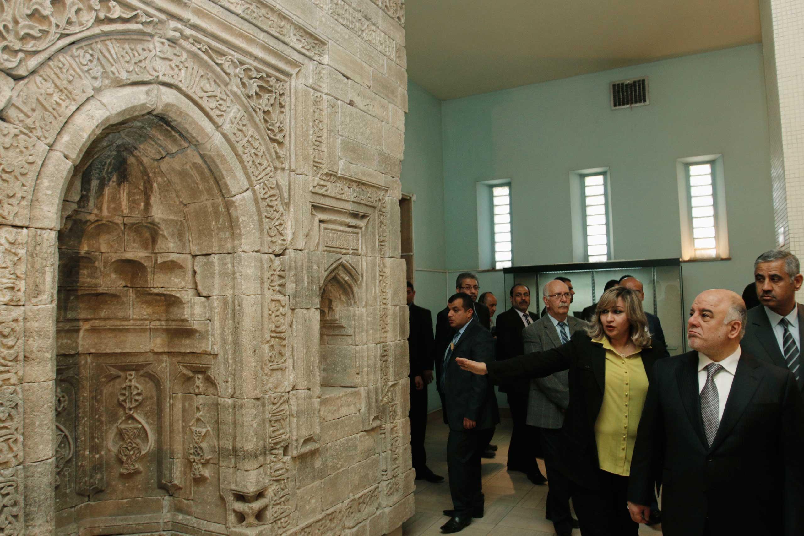 Iraqi Prime Minister Haider al-Abadi, right, visits the Iraqi National Museum in Baghdad Feb. 28, 2015.