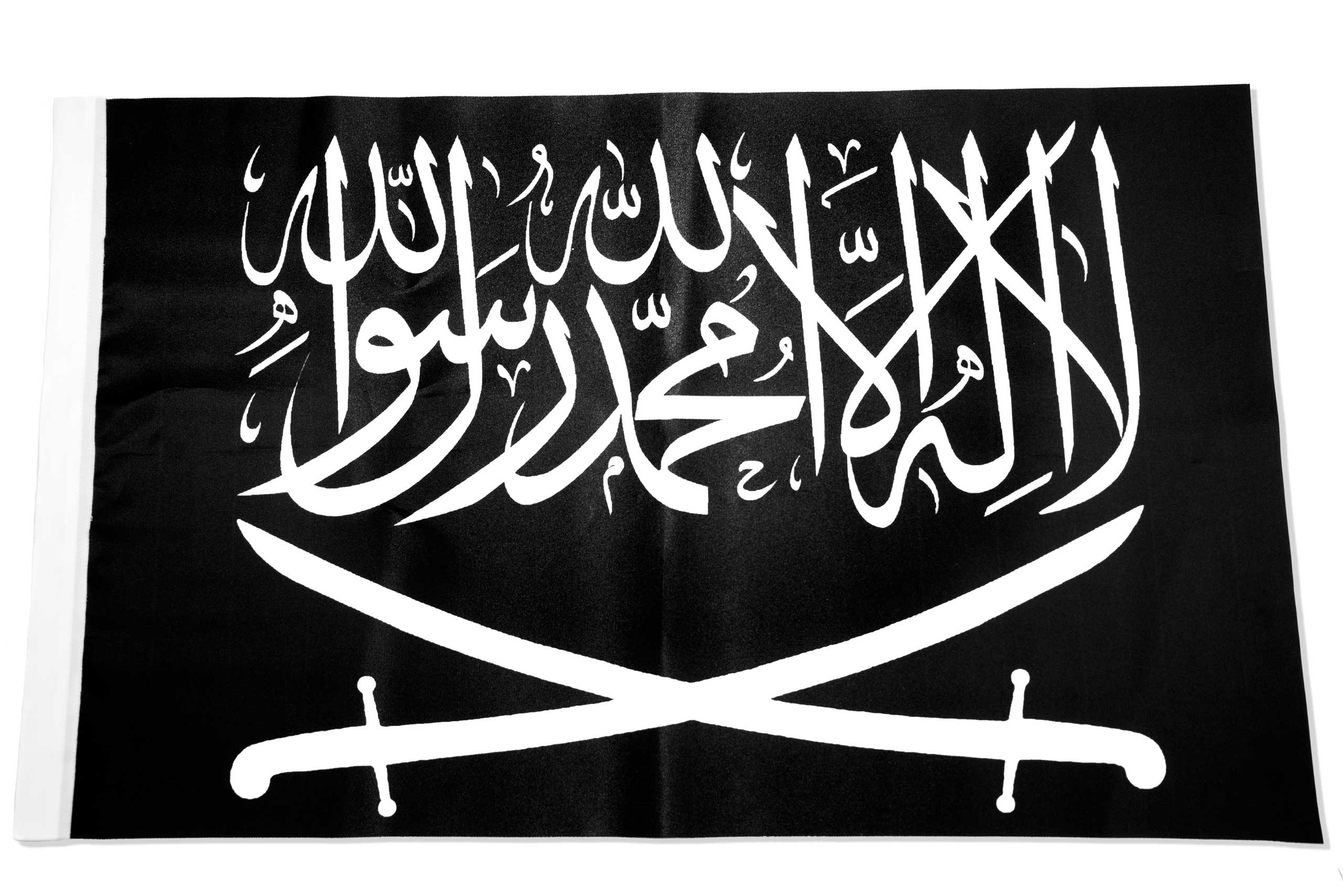 The black flag associated with Jihad or Al Raya - it has been a symbol of religious fighting and battles since the founding of Islam in the seventh century. Prophet Muhammad and many of his companions are said to have carried a similar flag into battle. This item was found in a Islamic clothing and accessory shop in the Bagcilar district of Istanbul, Turkey.