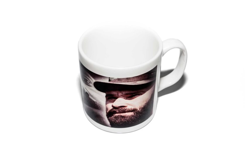 Items of clothing and objects found in a Islamic clothing and accessory shop in the Bagicilar district of Istanbul. A western style tea mug with a millitant commaners portrait on the side.