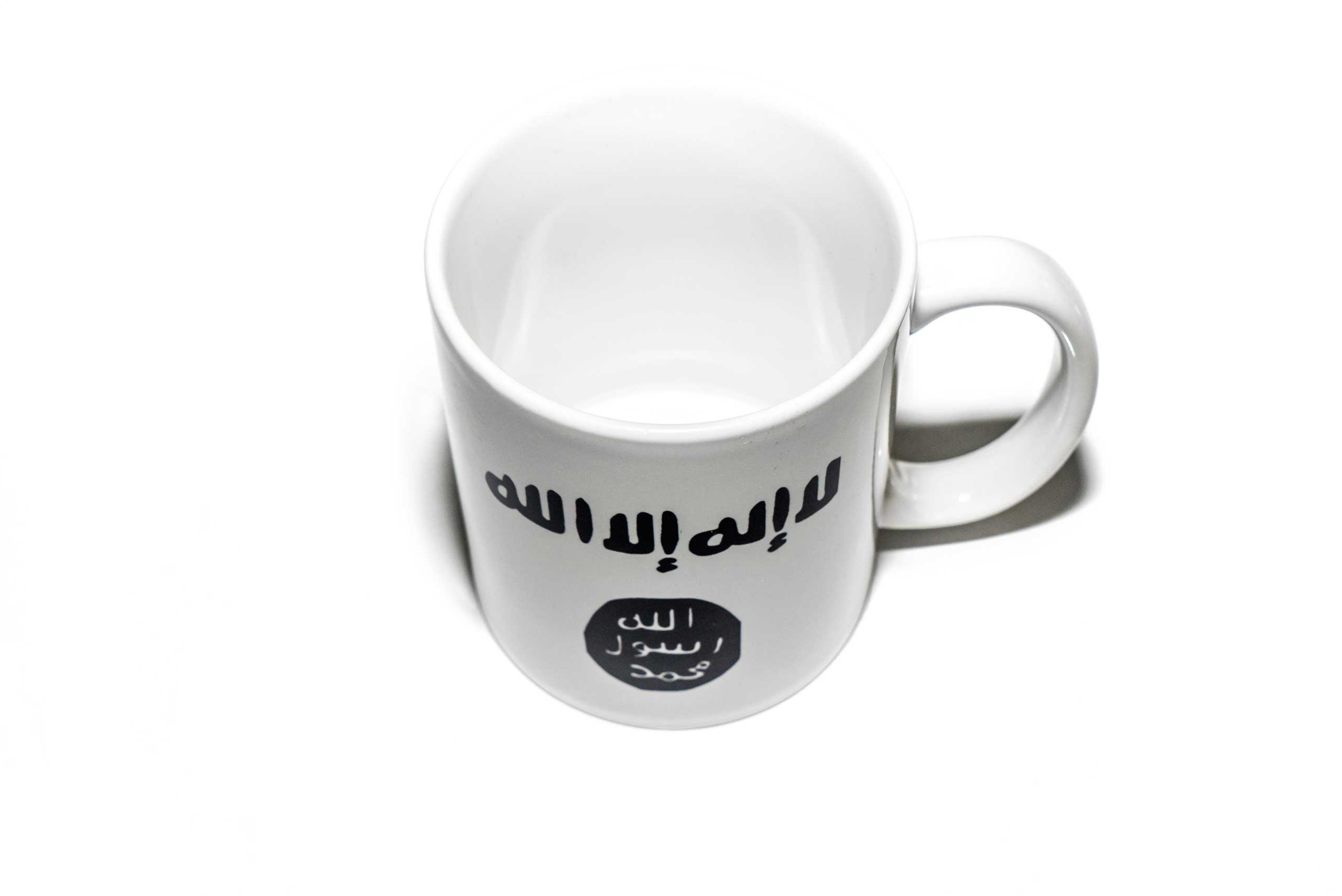 A  mug with the iconography of Islamic State on the side, found in a Islamic clothing and accessory shop in the Bagcilar district of Istanbul, Turkey.