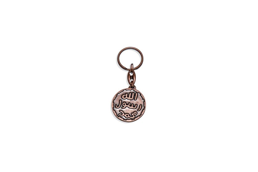 Items of clothing and objects found in a Islamic clothing and accessory shop in the Bagicilar district of Istanbul. A keyring with the iconography of the seal of the prophet, the iconography is also being used by the Islamic State IS.