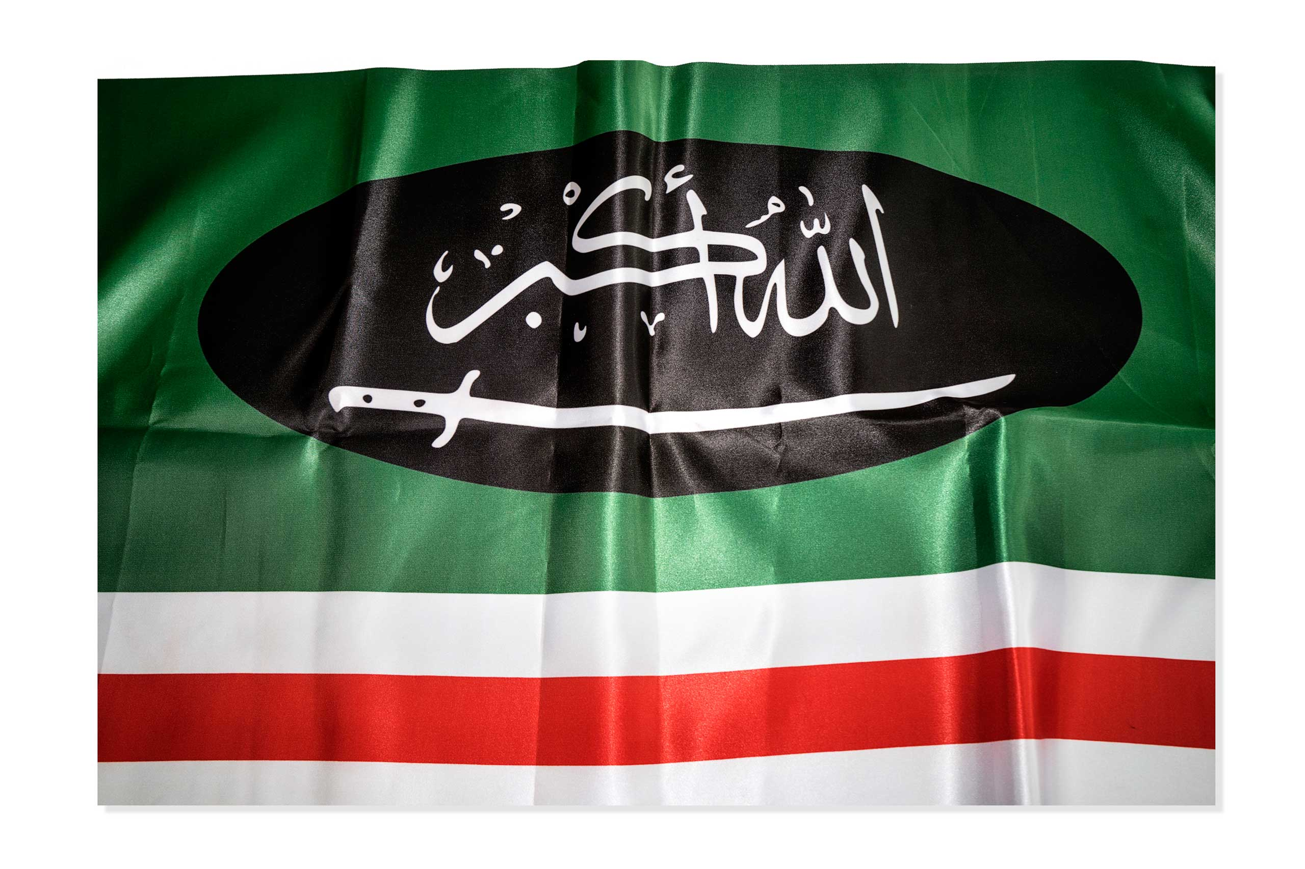 A modified version of the Caucasus Emirate flag used by the unrecognized secessionist government of the Chechen republic of Ichkeria was elected in 1991 but replaced by the Caucasus Emirate in 2007. This item was found in a Islamic clothing and accessory shop in the Bagcilar district of Istanbul, Turkey.