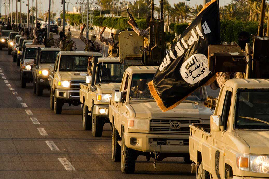 An image made available by propaganda Islamist media outlet Welayat Tarablos allegedly shows members of the Islamic State (IS) militant group parading in a street in Libya's coastal city of Sirte, released on Feb. 18, 2015.