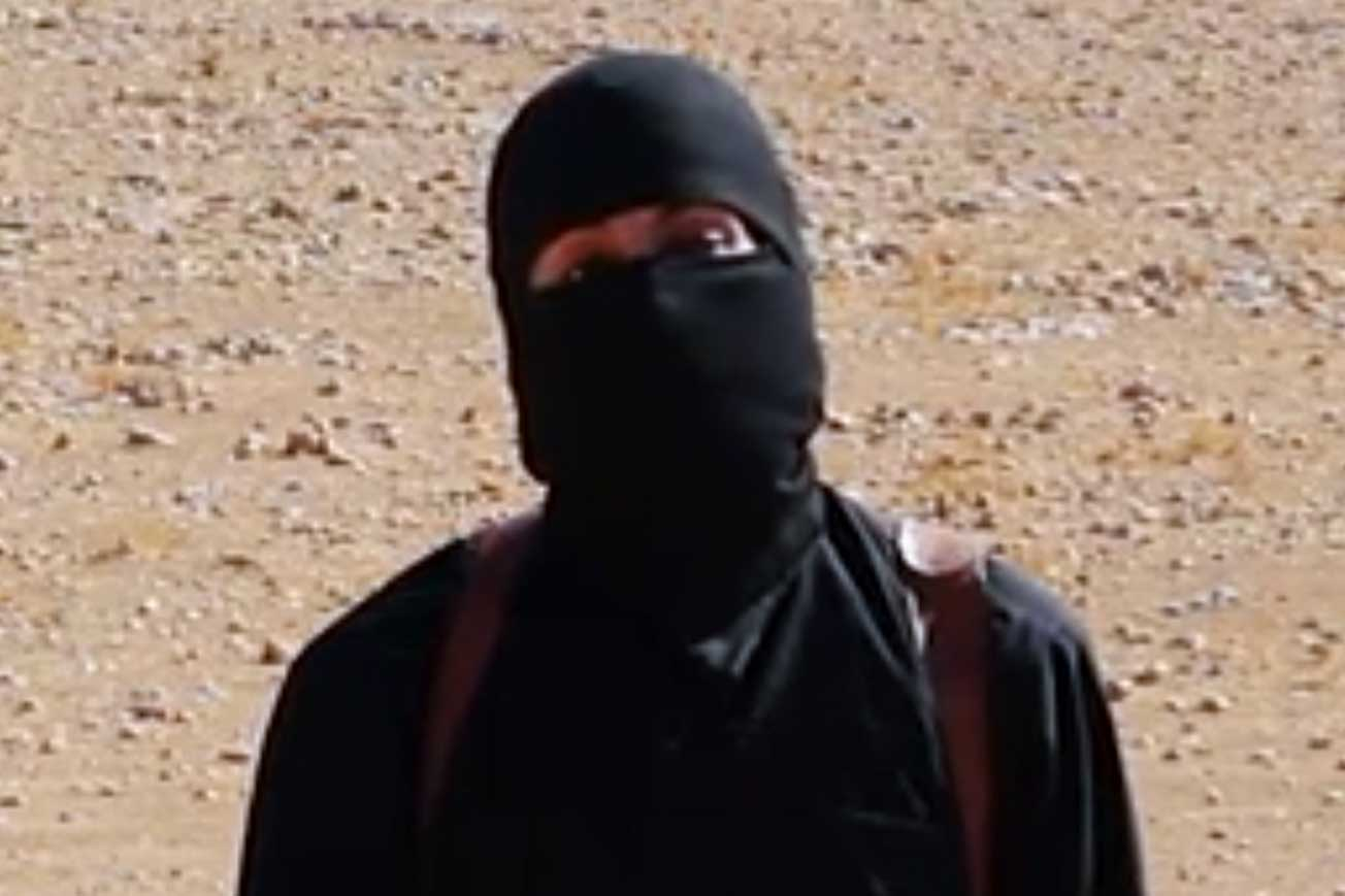 This frame from a video released by Islamic State militants purports to show 'Jihadi John' before the alleged killing of taxi driver Alan Henning, released on Oct. 3, 2014.