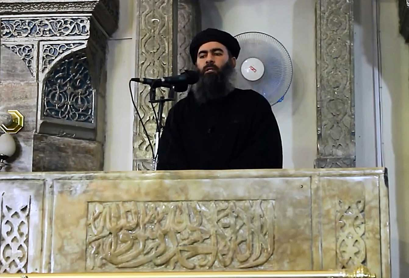 ISIS leader Abu Bakr al-Baghdadi, seen in this video screengrab, at the mosque in Mosul in 2014.