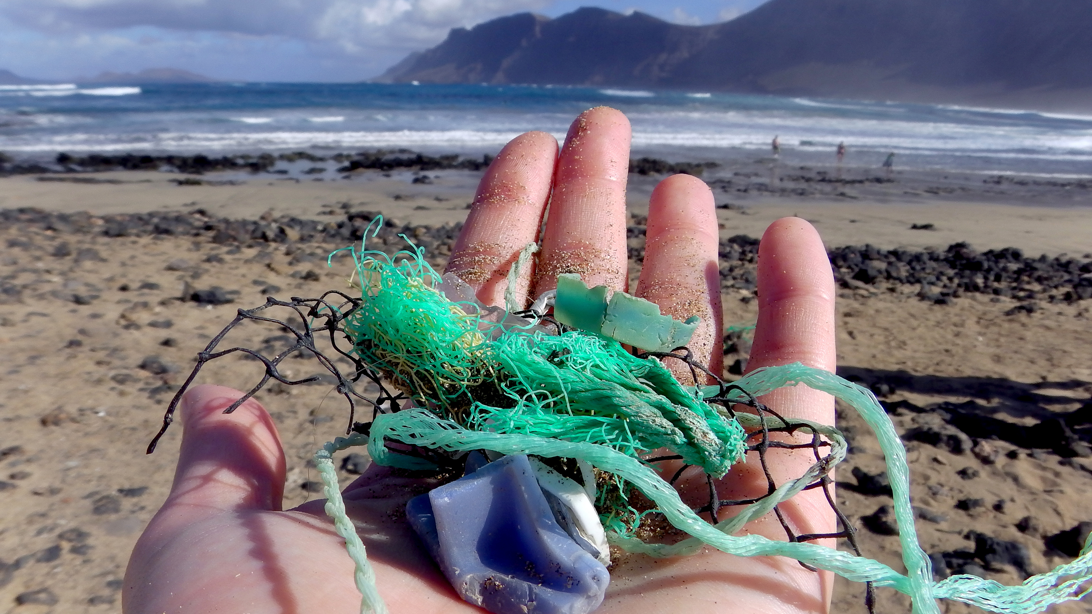 Study author Jenna Jambeck of the University of Georgia collects plastic samples from a beach near Caleta de Famara, Canary Islands, Spain.