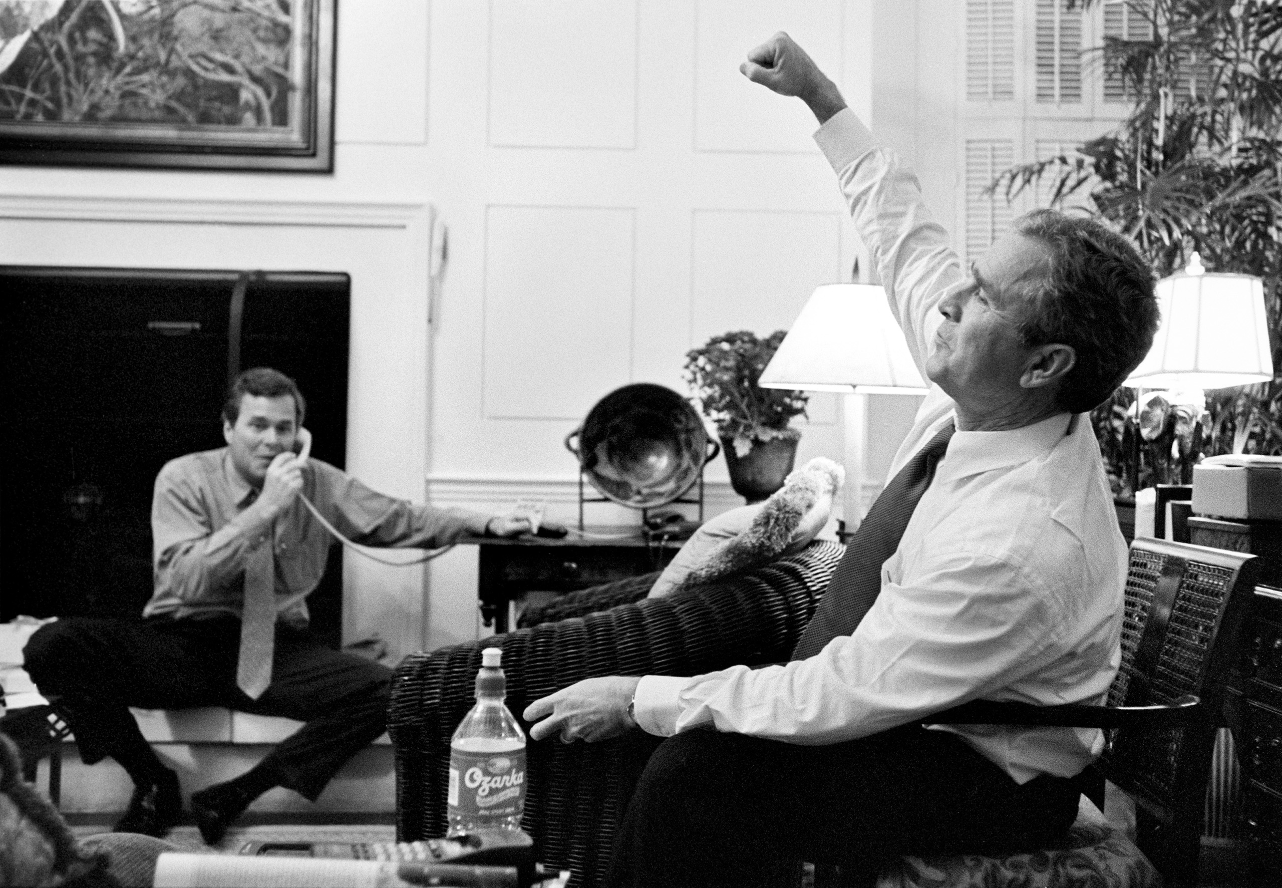 Texas governor George W. Bush celebrates good news with his brother, Florida governor Jeb Bush, while watching the presidential election returns, prior to being elected as President of the United States, inside the Governor's Mansion in Austin, Nov. 7, 2000.