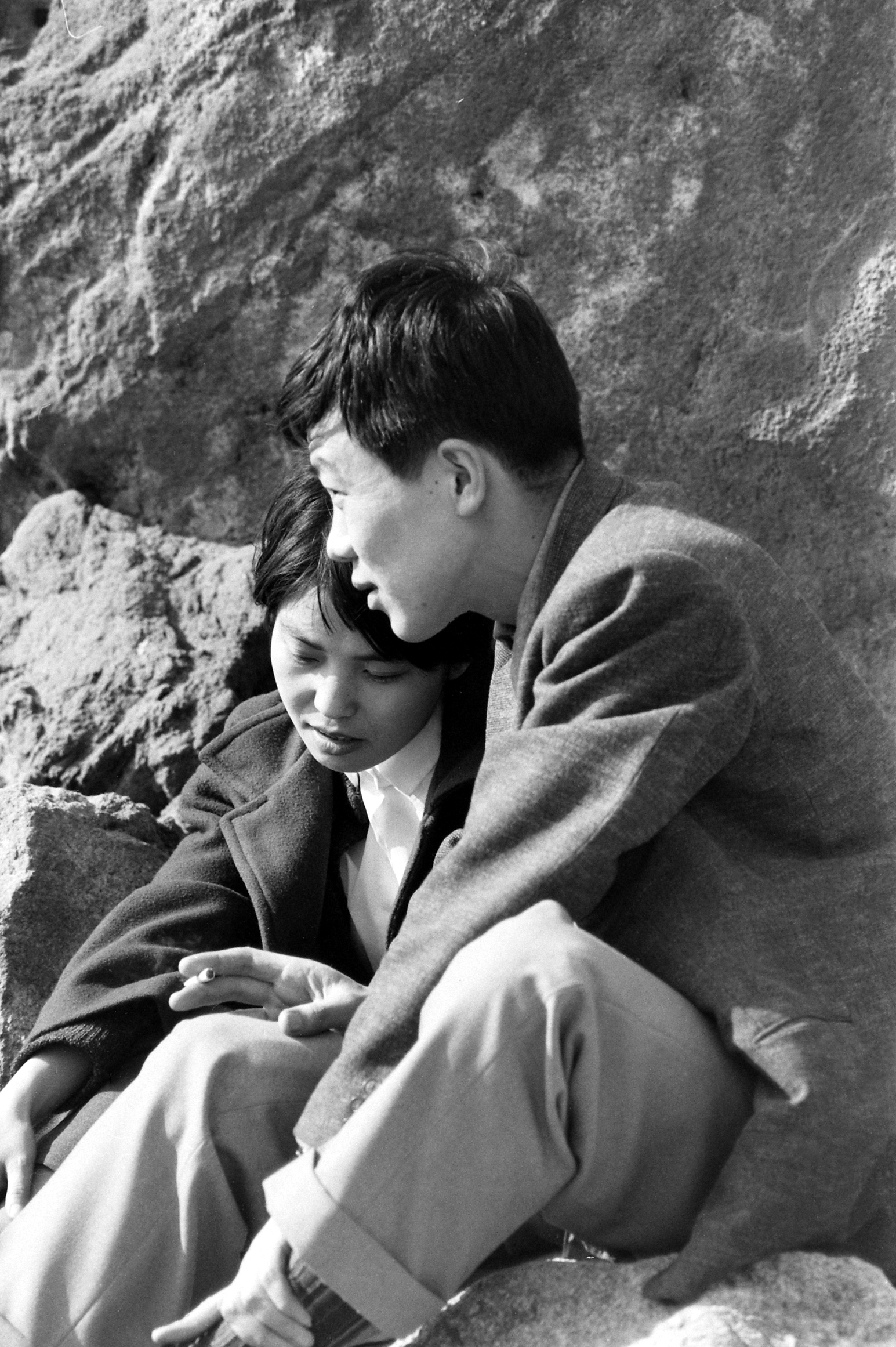 Chiyoko Inami, left, and her boyfriend, Akiksuke Tsutsui, right, sharing an intimate moment on a date.  March, 1959.
