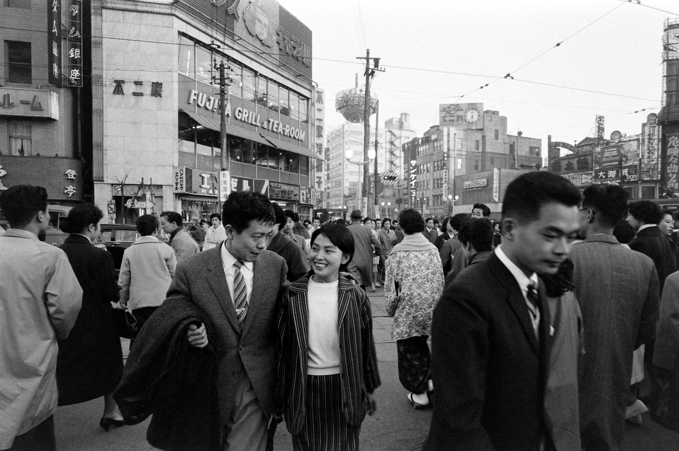 Akiksuke Tsutsui, left, and his girlfriend Chiyoko Inami, right, walking around in the Ginza district during their lunch hour.  March 1959.