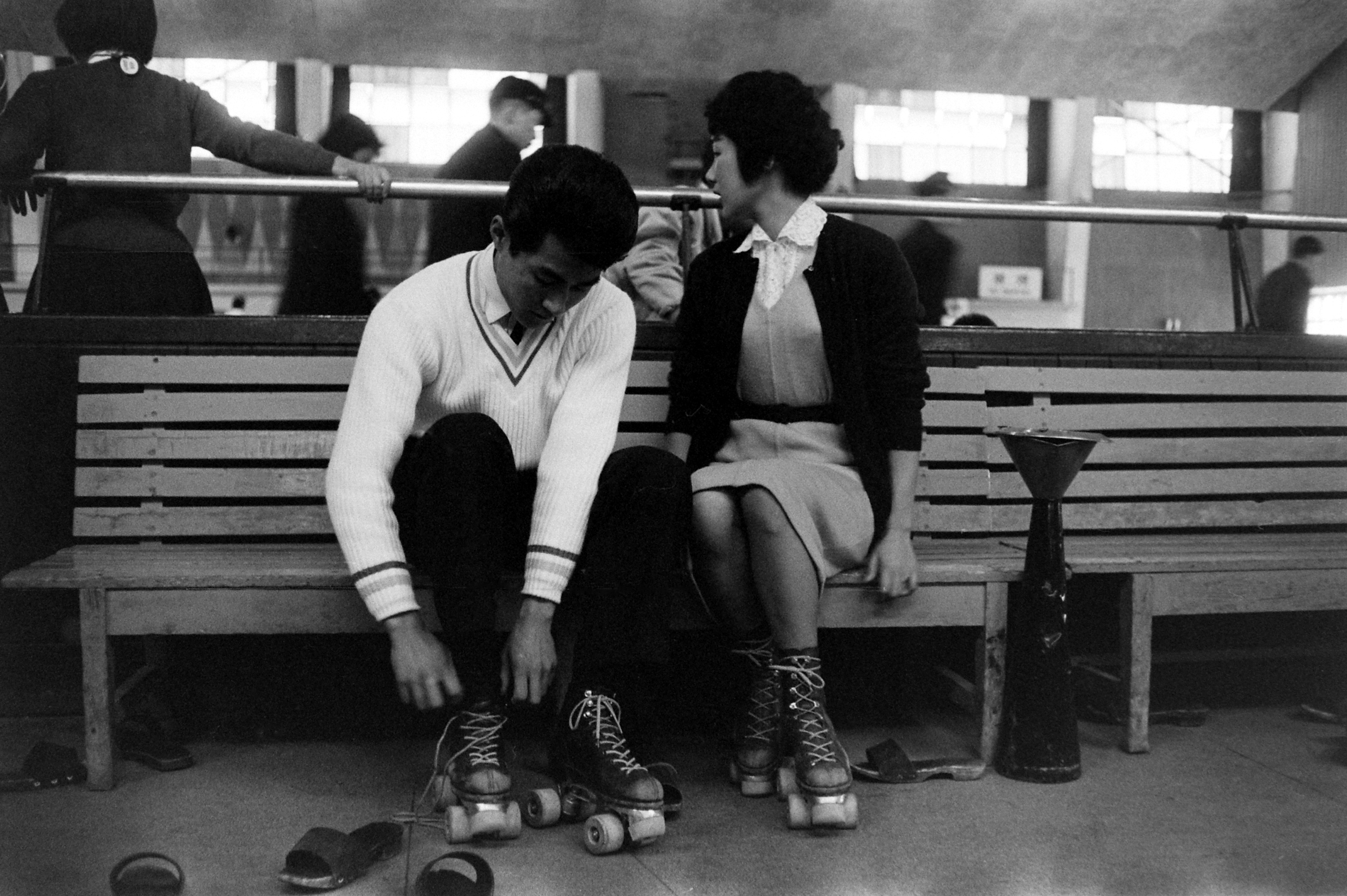 Nohito Mukai, left, and his girlfriend, Hiroko Inayaki, go roller skating on a date in Tokyo.  March 1959.