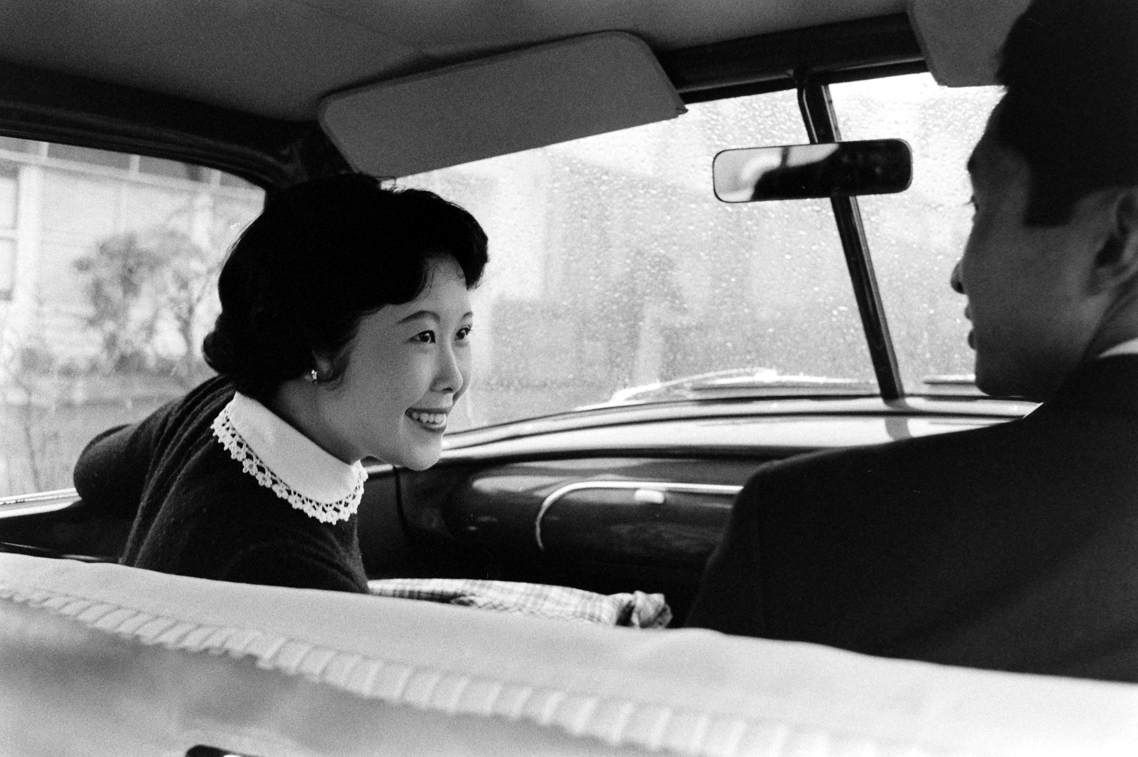 Hiroko Inayaki, left, goes for a drive with her boyfriend, Nohito Mukai.  March 1959.
