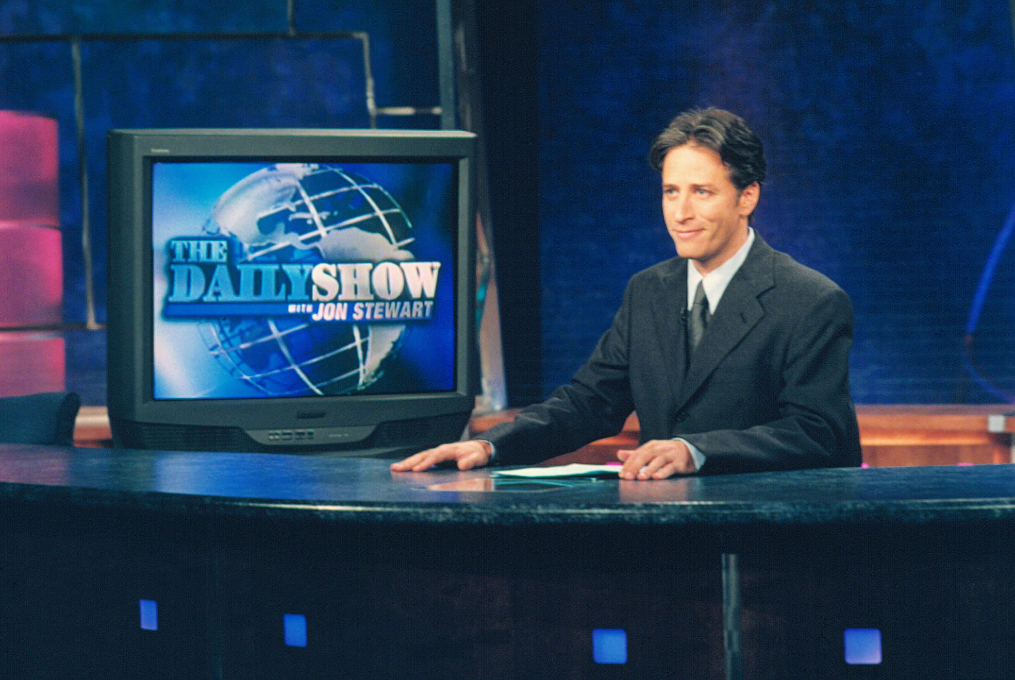 Jon Stewart takes the reins as anchor of <i>The Daily Show</i> in 1999.