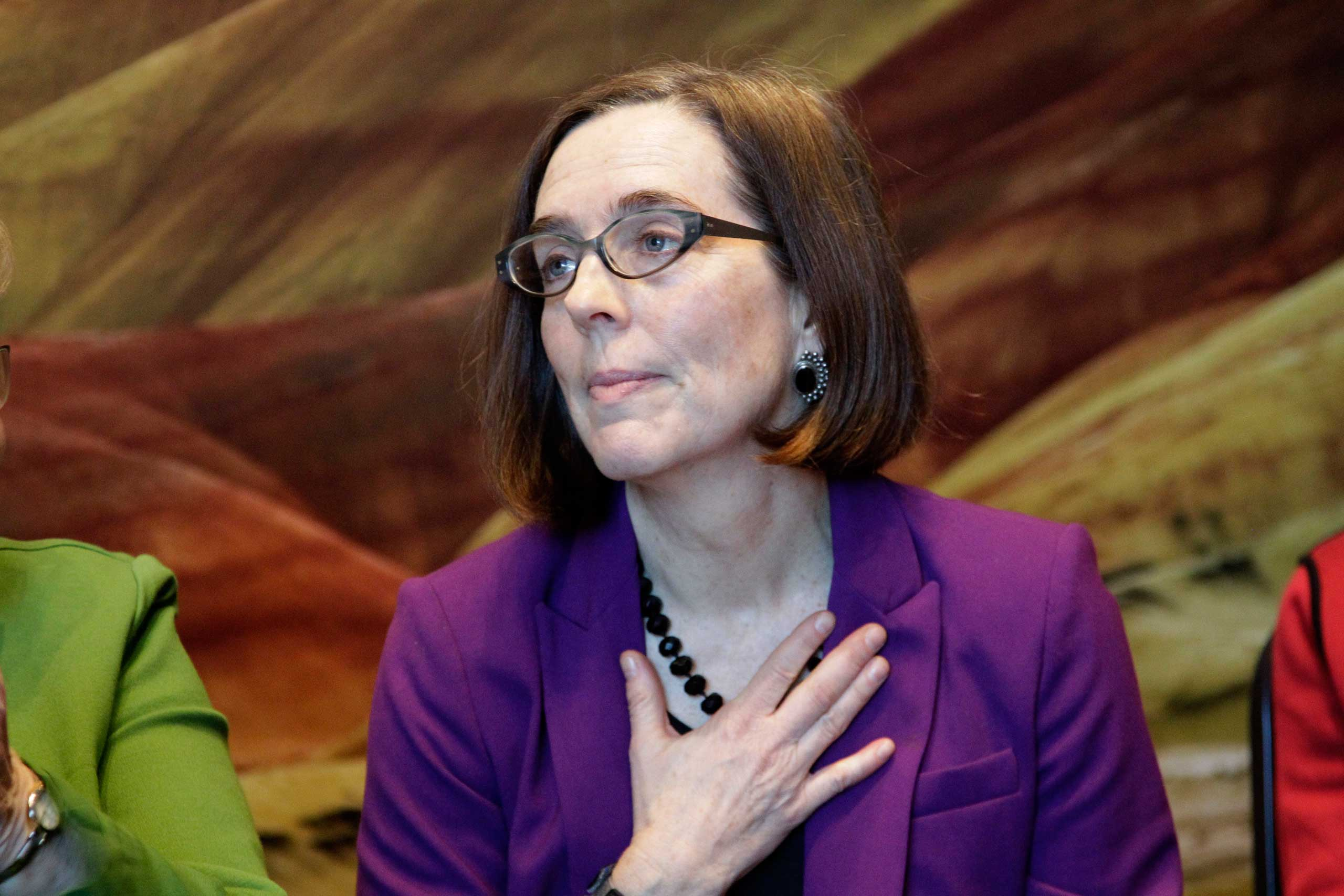 Then-Oregon Secretary of State Kate Brown is shown during a celebration at the Oregon Historical Society to mark the 156th anniversary of Oregon's admission to the union as the 33rd state in Portland, Ore., Feb. 14, 2015.