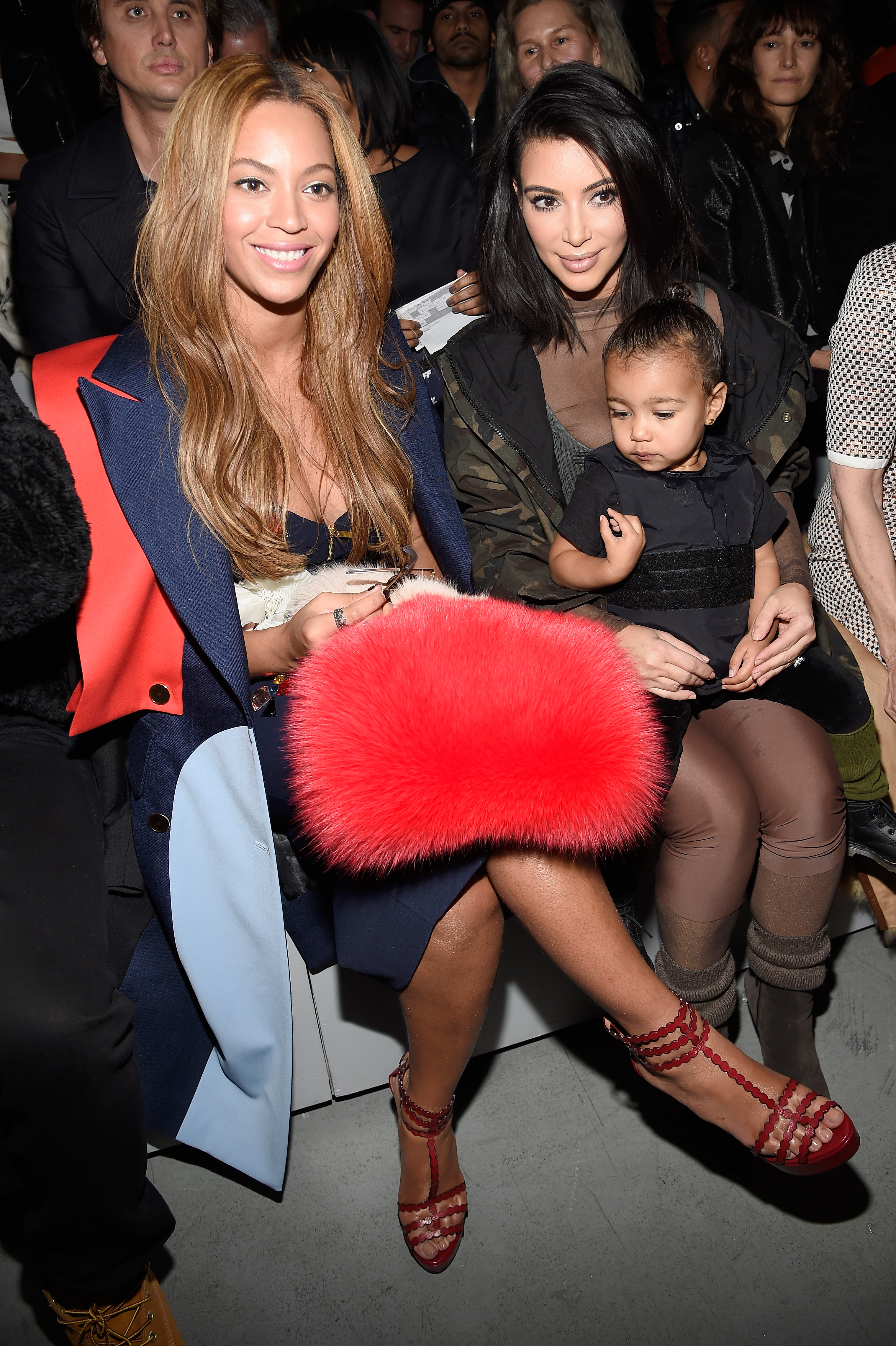 Beyonce, Kim Kardashian, and daughter North attend the adidas Originals x Kanye West YEEZY SEASON 1 fashion show during New York Fashion Week Fall 2015 at Skylight Clarkson Sq on February 12, 2015 in New York City.