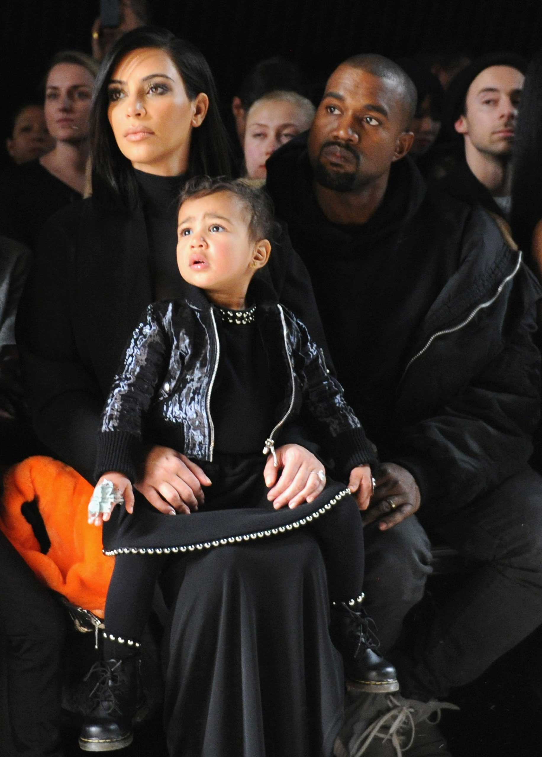 Kim Kardashian, North West and Kanye West attend the Alexander Wang Fashion Show during Mercedes-Benz Fashion Week Fall 2015 at Pier 94 on Feb. 14, 2015 in New York City.