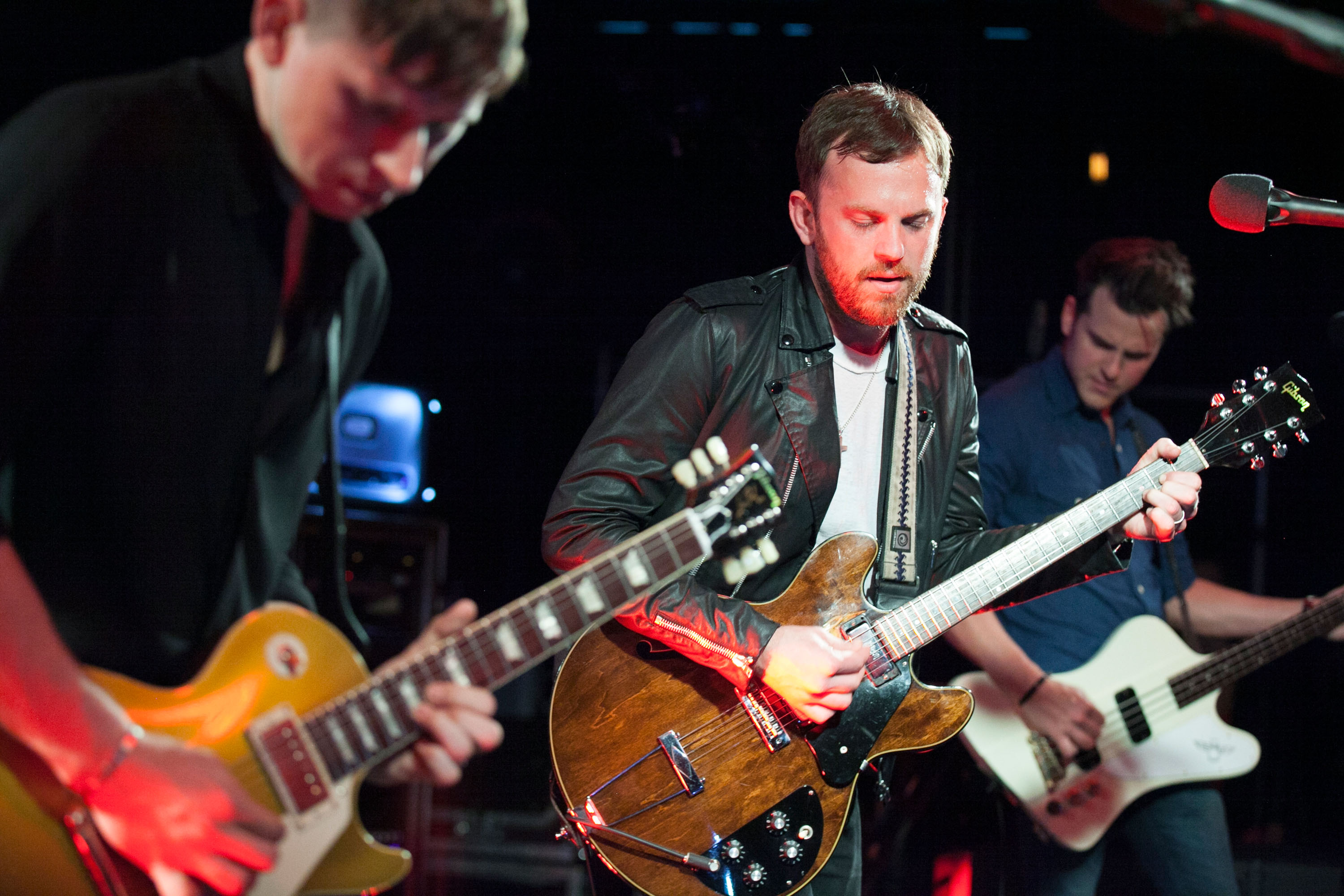 (left-right) Matthew Followill, Caleb Followill and Jared Followill of The Kings of Leon perform At The Red Bull Sound Space At KROQ on March 24, 2014 in Los Angeles.