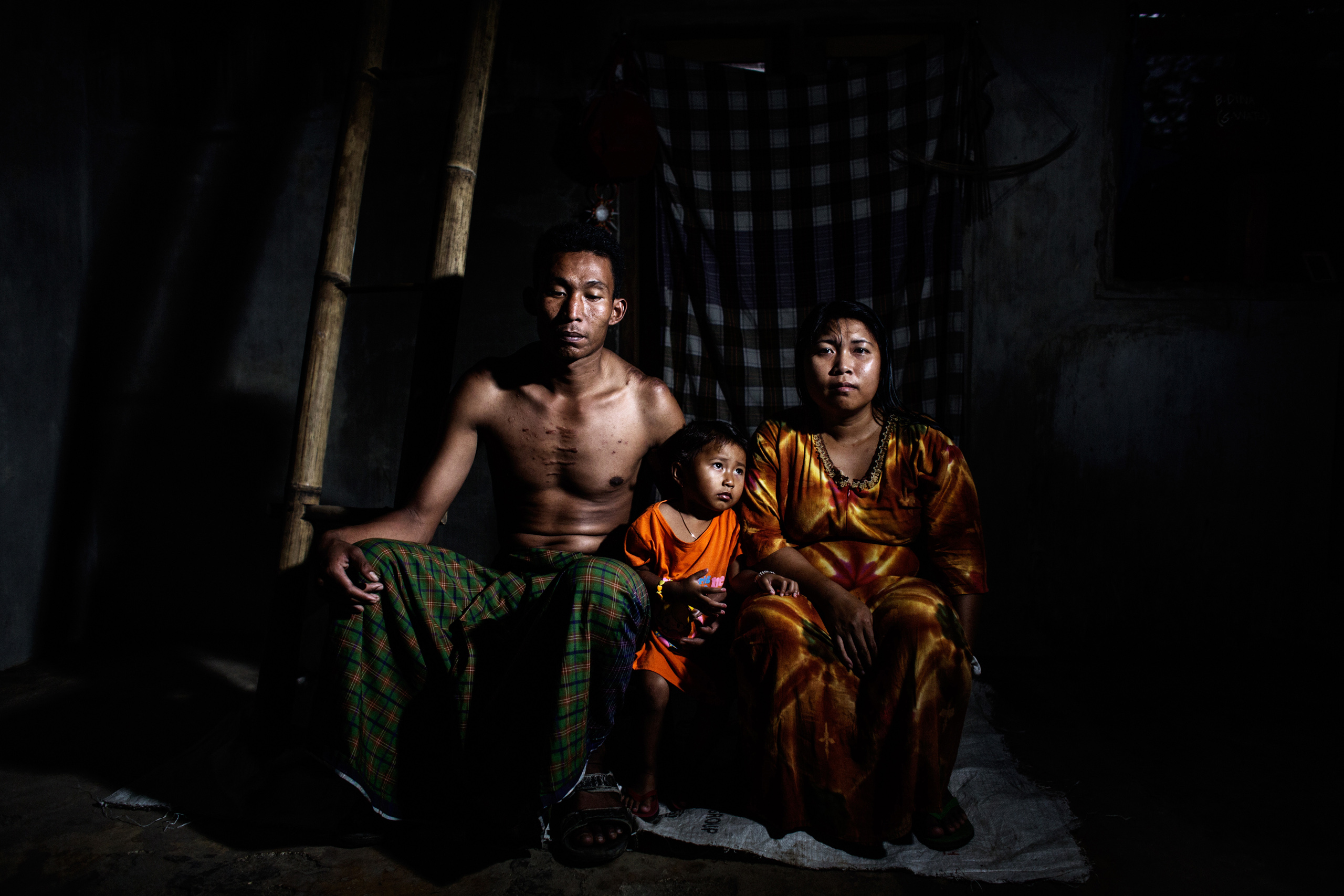 Suwono, 33, with his wife Isniyab and son Reny. He has been working with sulfur for nine years. Oct. 30, 2014.