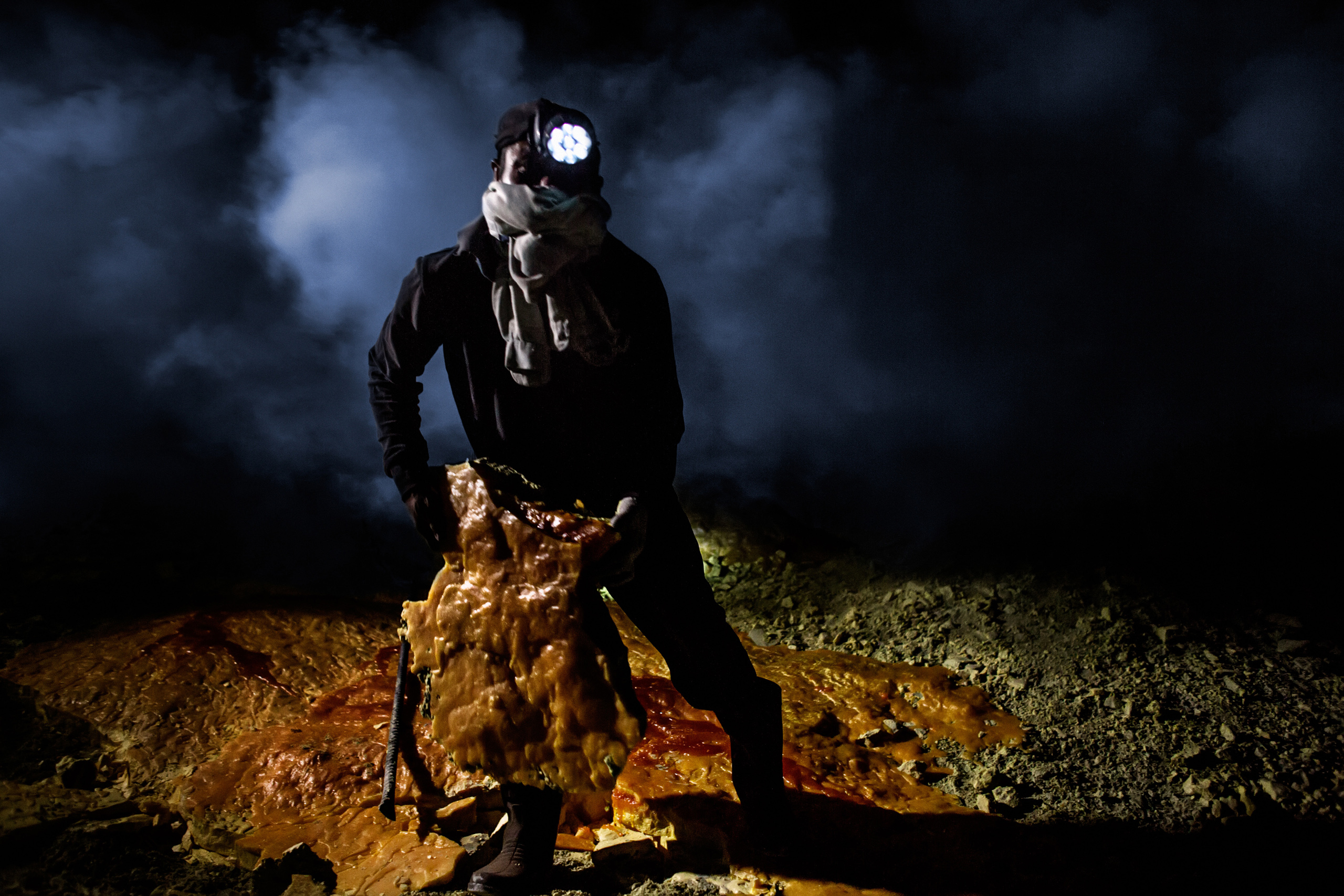 Zainuri, 26, a sulfur miner for the past eight years, removes a sulfur slab,  Nov. 2, 2014.