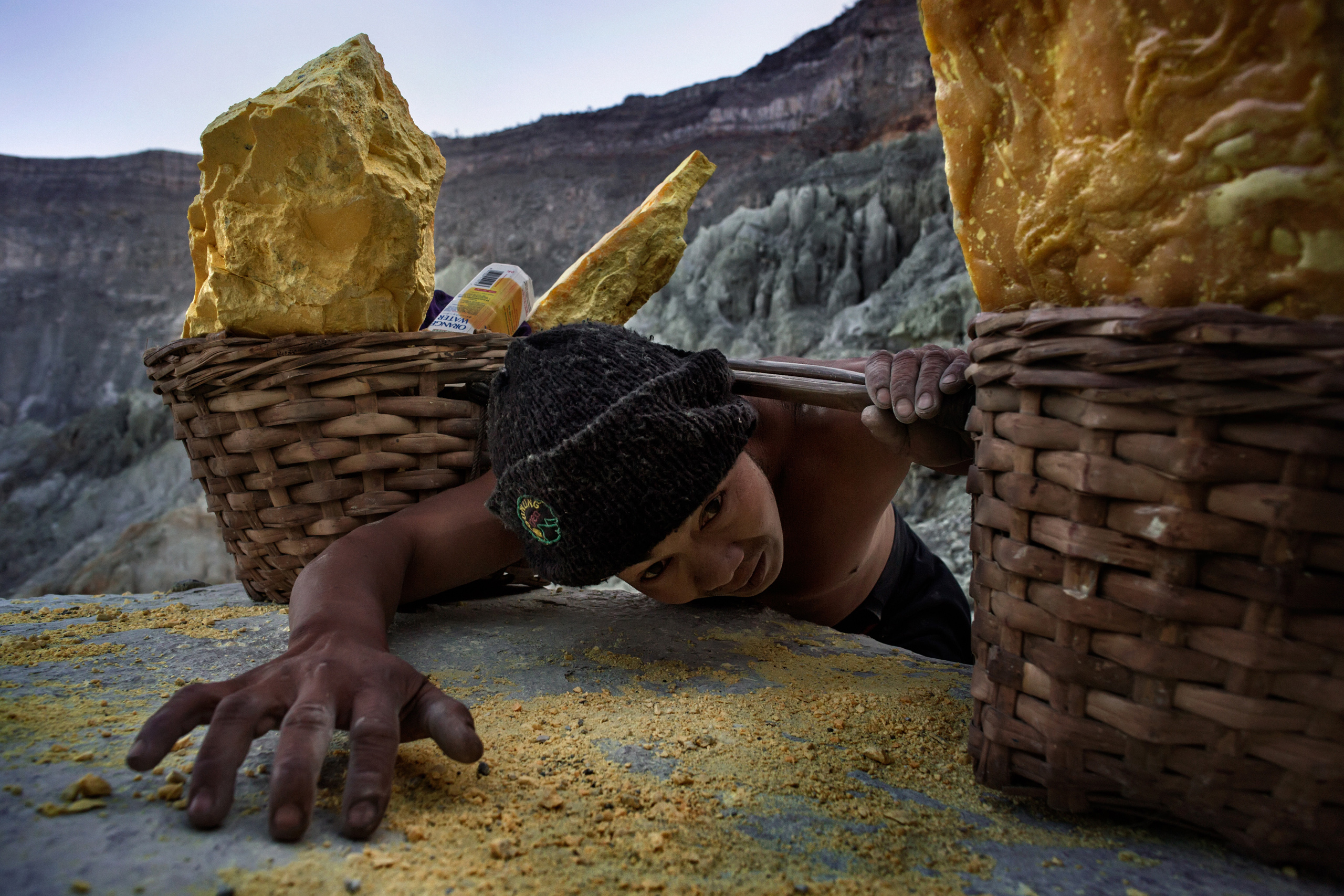 Sahron, 36, catches his breath as he climbs the volcano's steep slopes carrying 150 lb. of sulfur.  Nov. 3, 2014.