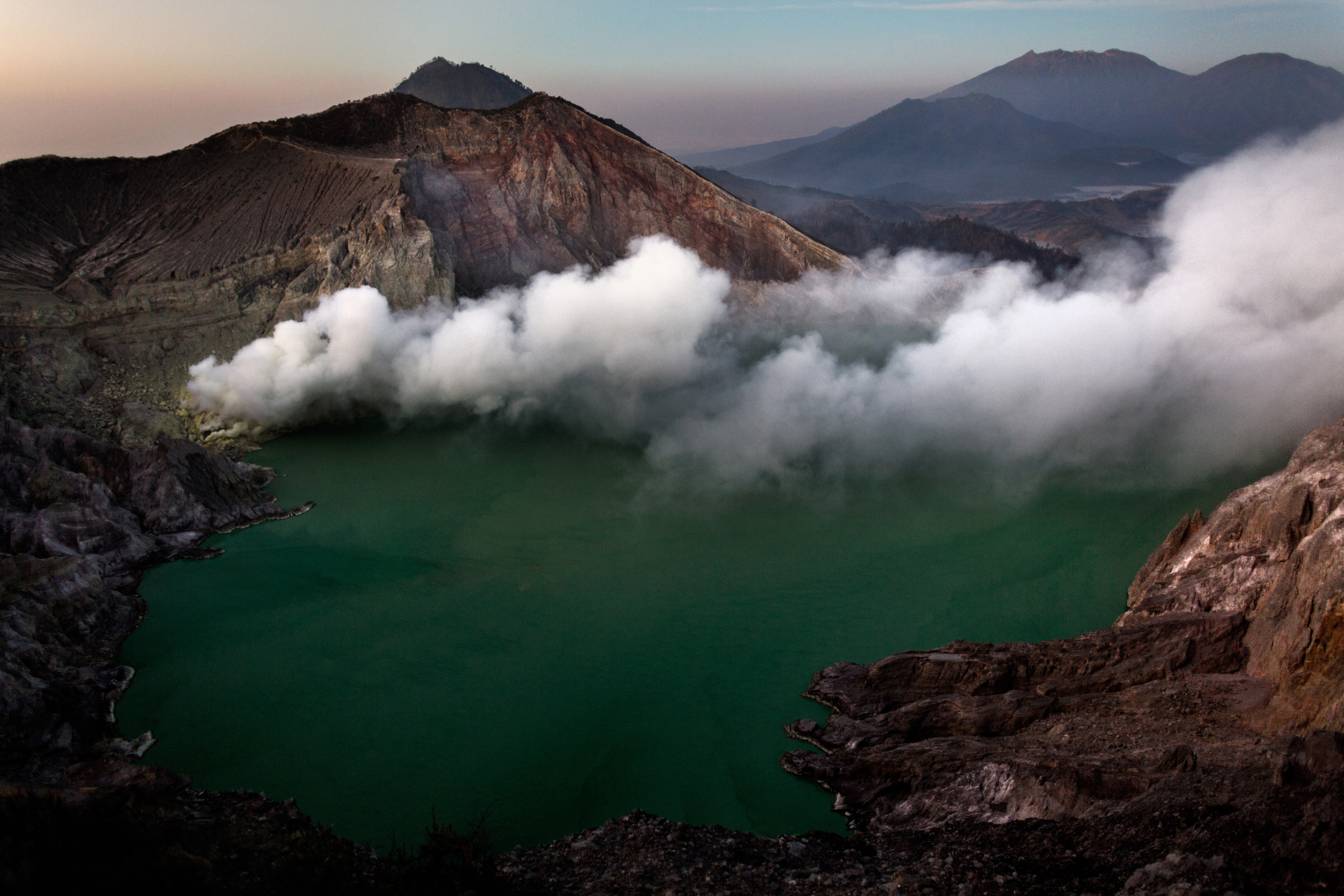 Kawah Ijen, the volcanic crater lake, in Indonesia's eastern Java, is where miners go in search of sulfur, Oct. 28, 2014.